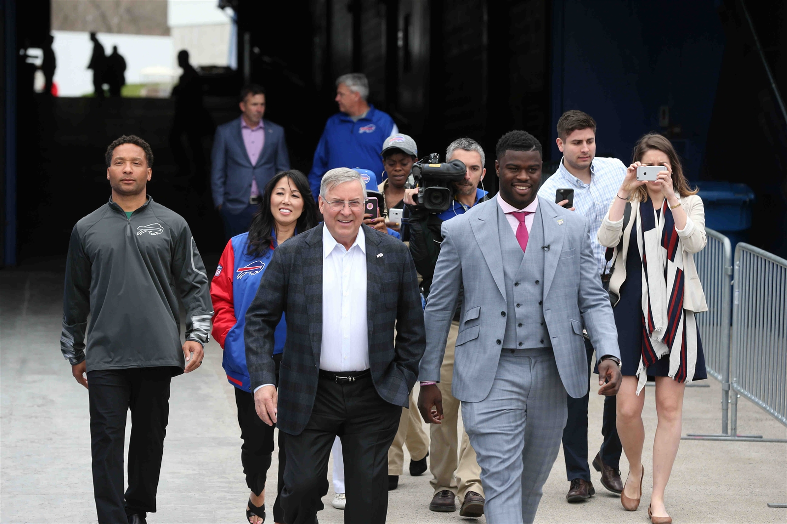 Shaq Lawson leads the way along with Bills owner Terry Pegula, followed by GM Doug Whaley, owner Kim Pegula, and, further back, team president Russ Brandon and coach Rex Ryan. (James P. McCoy/Buffalo News)