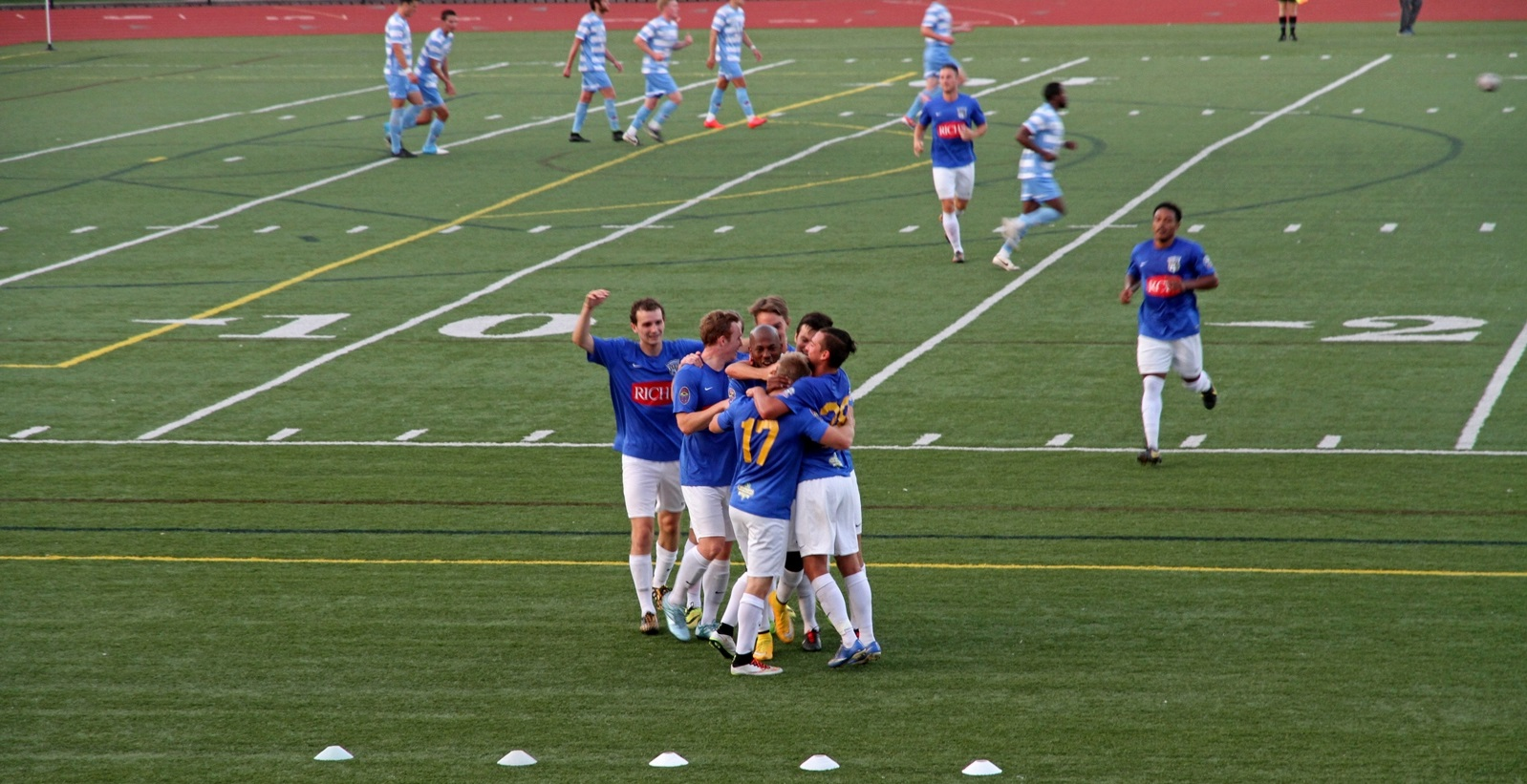 FC Buffalo celebrates a goal in its crucial 2015 win over Lansing United. (Erica Morano/Special to The News)