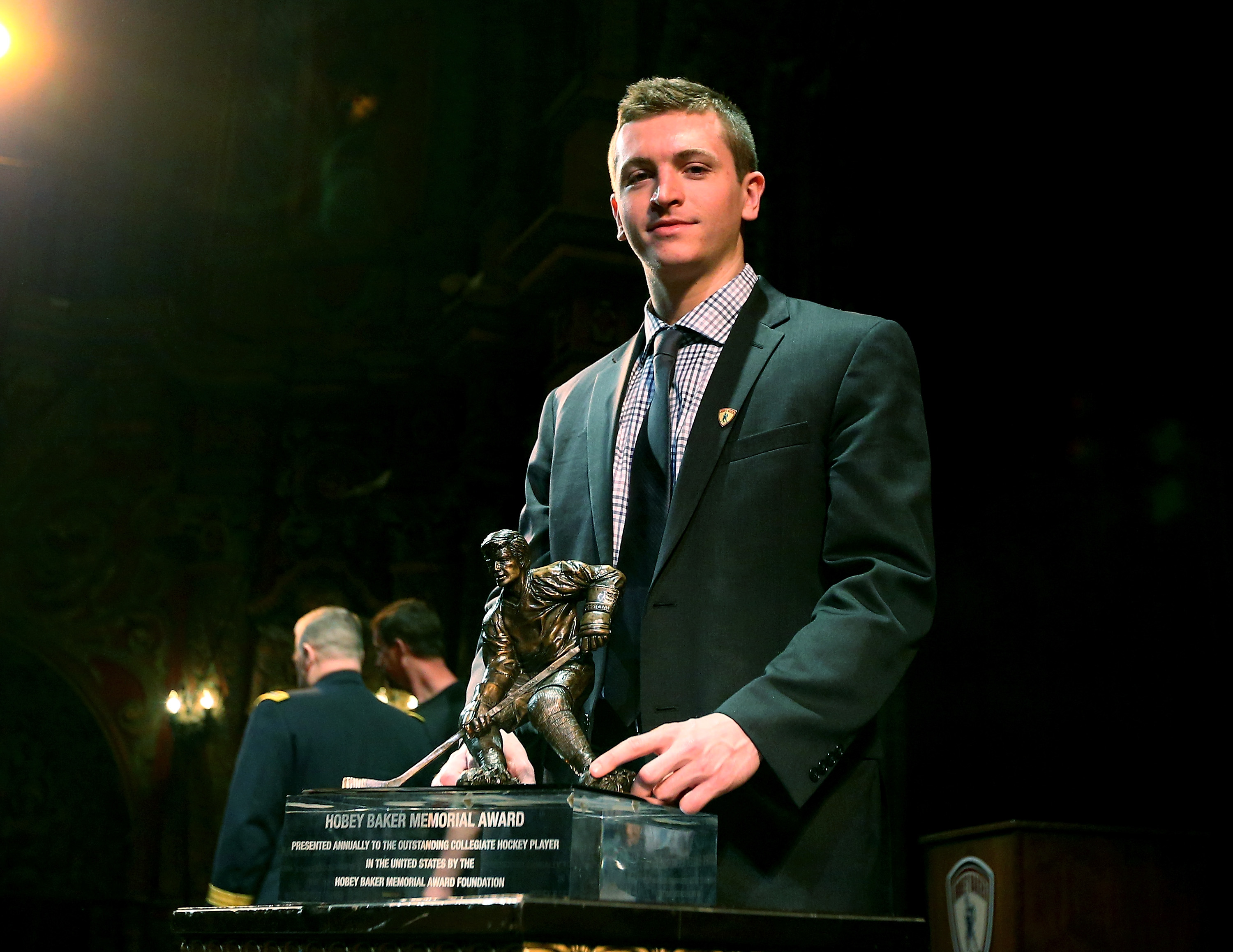 Jimmy Vesey of Harvard University poses with the Hobey Baker Award trophy after the award ceremony in April. (Getty Images)