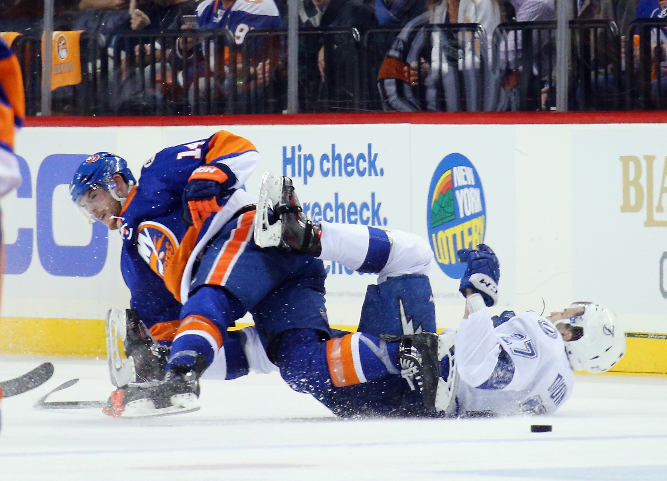 Thomas Hickey of the New York Islanders checks Jonathan Drouin of the Tampa Bay Lightning during the second period in Game Three of the Eastern Conference second round Tuesday night. (Getty Images)