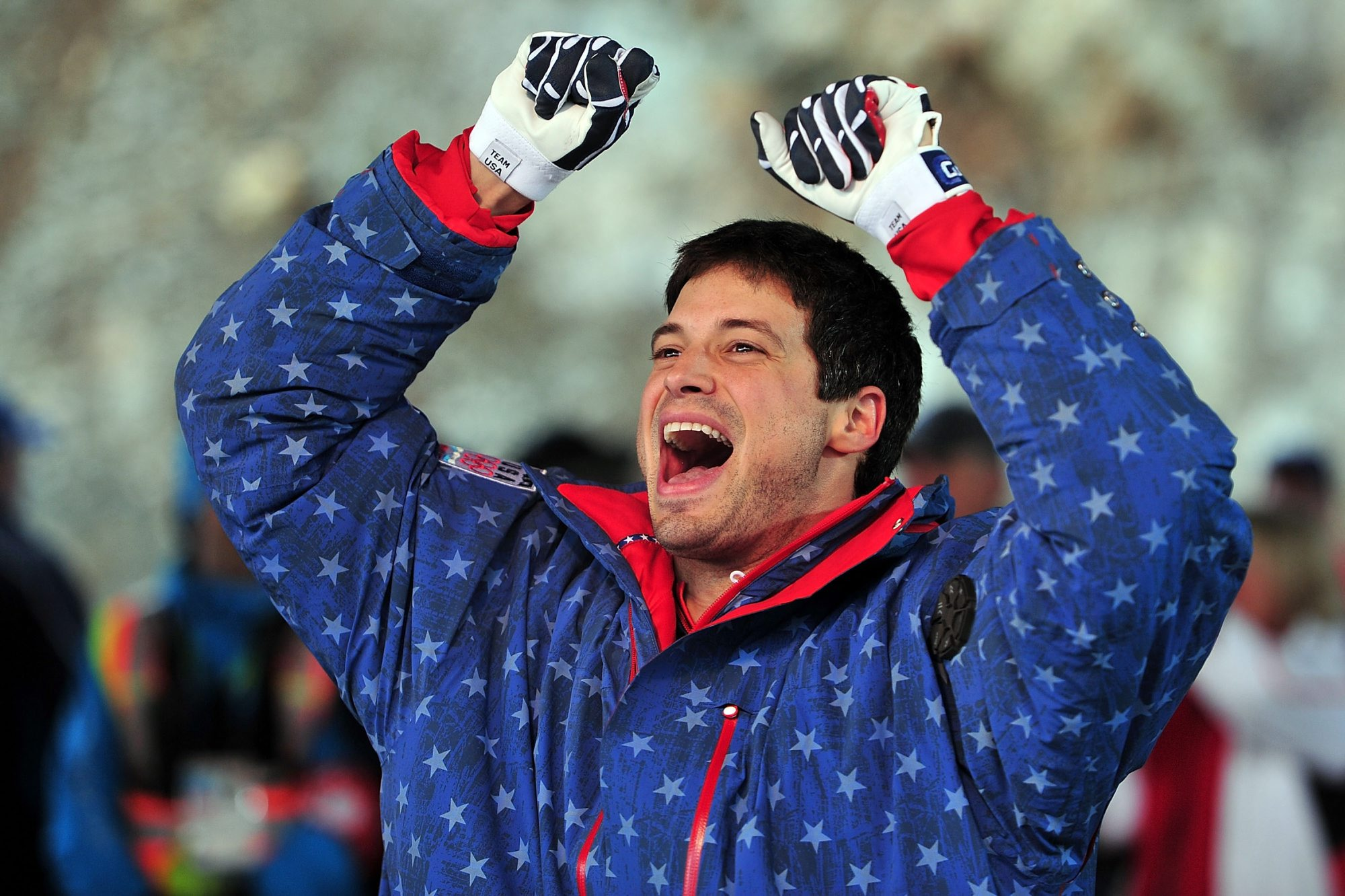 Steve Mesler celebrates after winning the gold medal in the men's four man bobsled at the 2010 Vancouver Winter Olympics. (Getty Images)