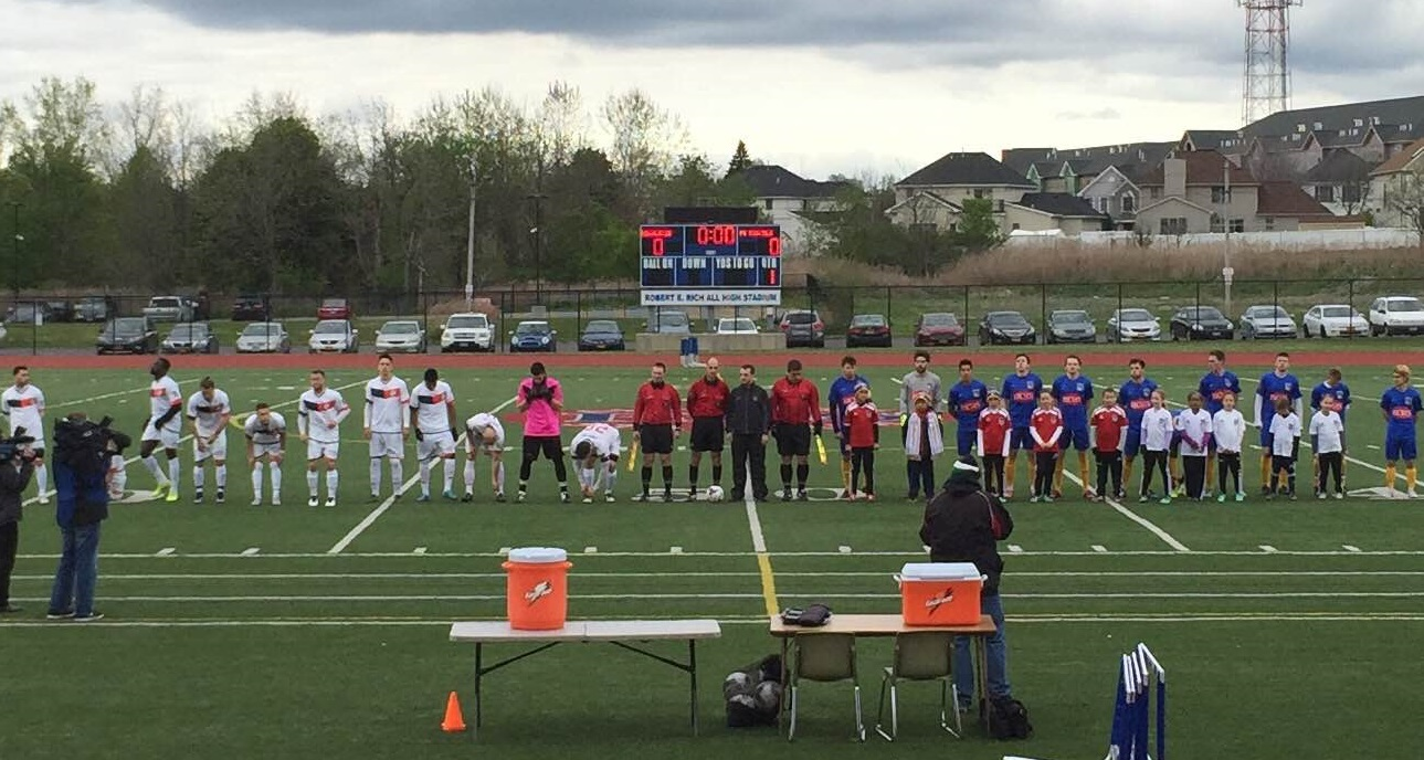 Starting lineups for FC Buffalo and Rochester face the crowd before Saturday's NPSL match. (Ben Tsujimoto/Buffalo News)