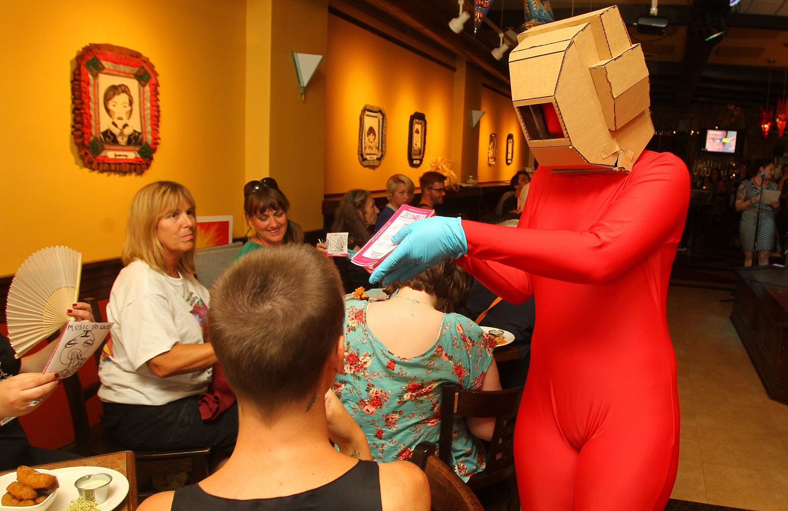 A robot for Lesionread passes out fliers during the media day showcase of art for the Infringement Festival at Merge in 2013. (Mark Mulville/Buffalo News file photo)