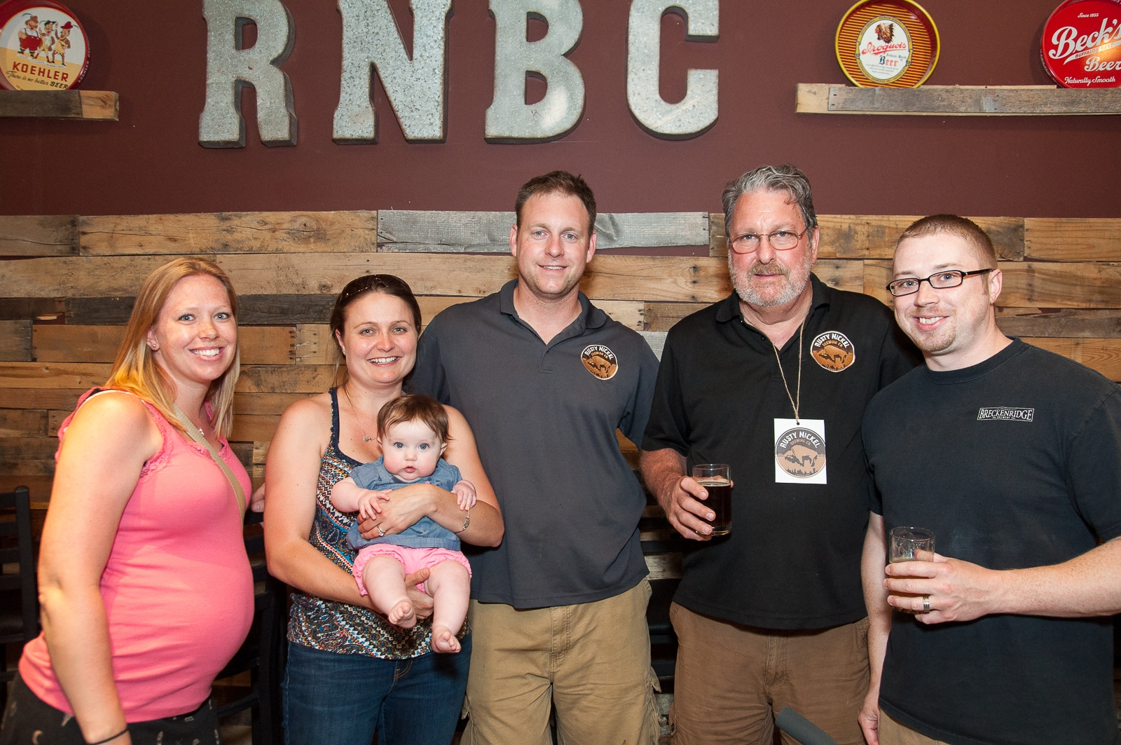 """Rusty Nickel co-owner Jason Havens, fourth from left, has """"Slice O'Havens"""" named after him."""