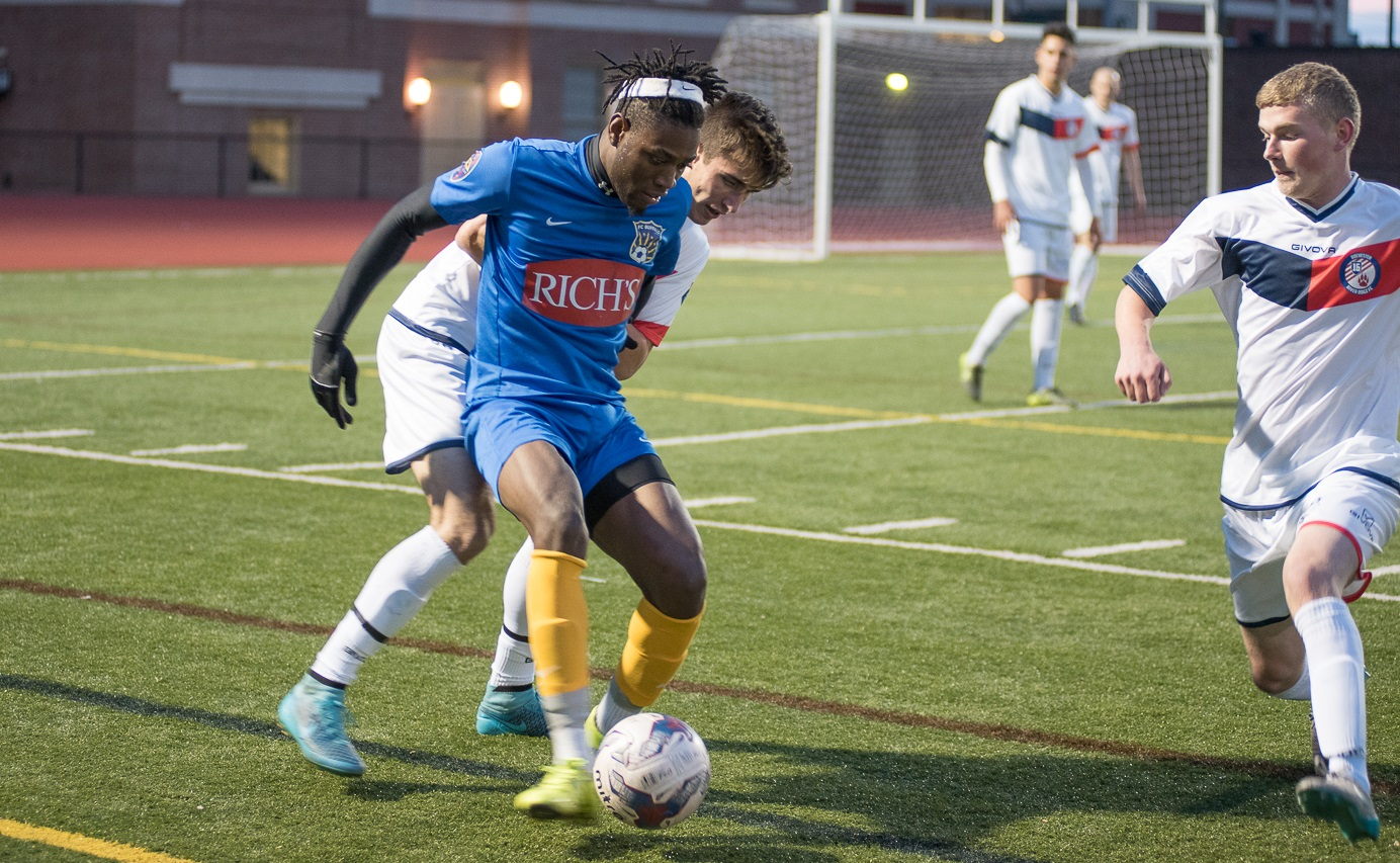 FC Buffalo's Romario Guscott, in blue, has improved as the season has worn on. (Matt Weinberg/Special to The News)