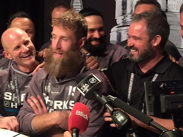 The Sharks' training staff made a surprise descent on Joe Thornton's Media Day podium to admire his lavish beard (Mike Harrington/Buffalo News).