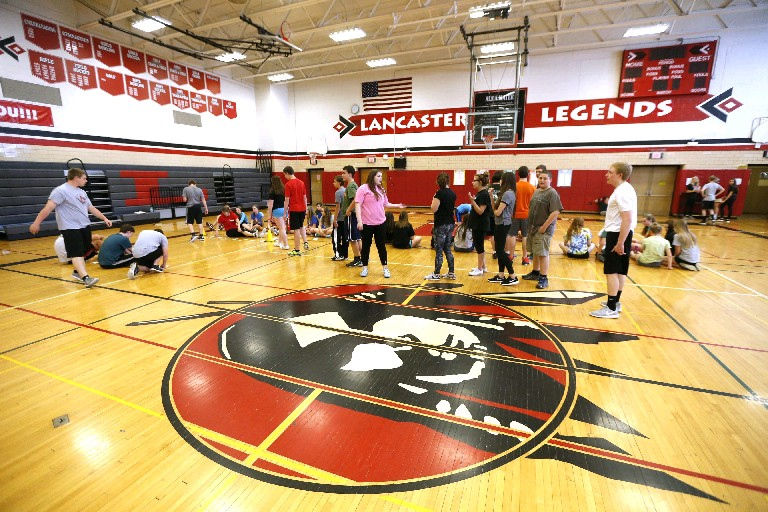 The gym at Lancaster High School has the new mascot on the wall and the old one on the floor. (Robert Kirkham/Buffalo News)