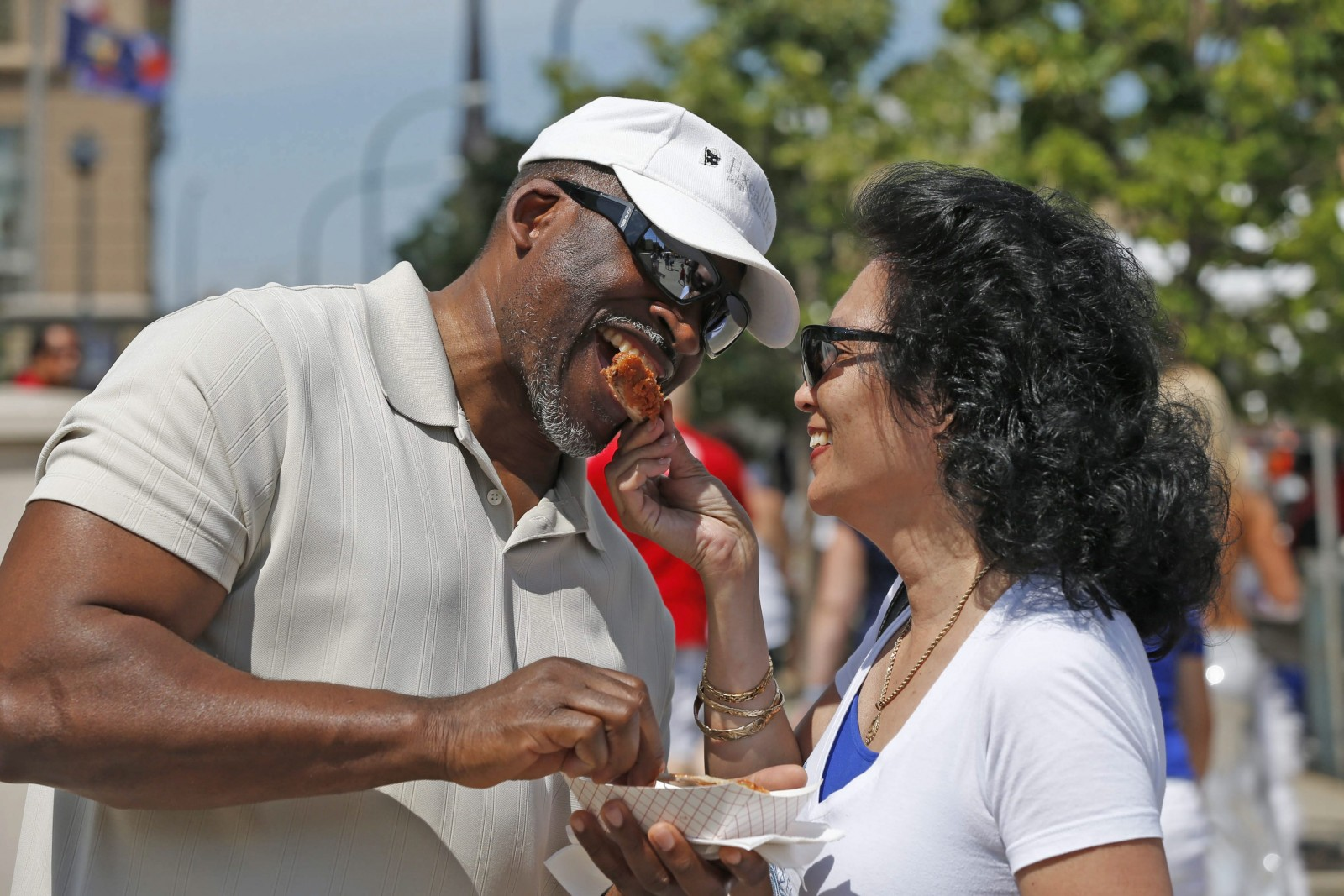Sammy Que, of East Amherst, and Antoinette Mantanona, of Seattle, sample some chicken wings during the 2014 Taste of Buffalo. (Robert Kirkham/News file photo)