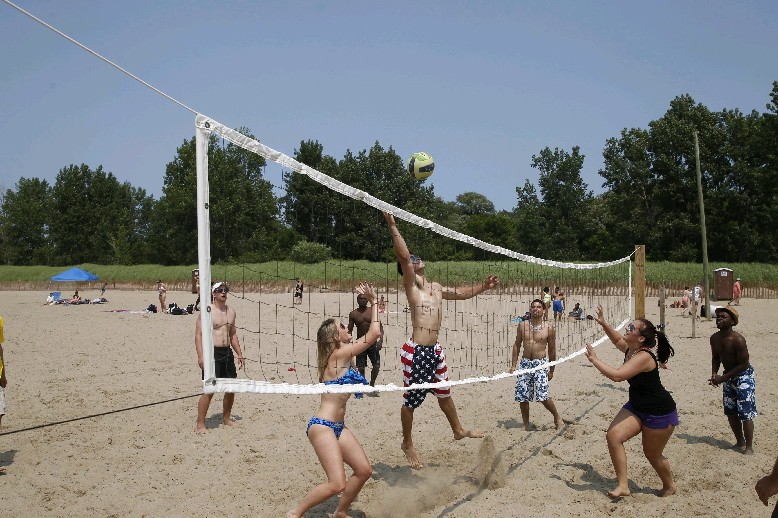 Beach volleyball enthusiasts can hone their skills for the season with summer-like conditions expected into early next week. (Buffalo News file photo)