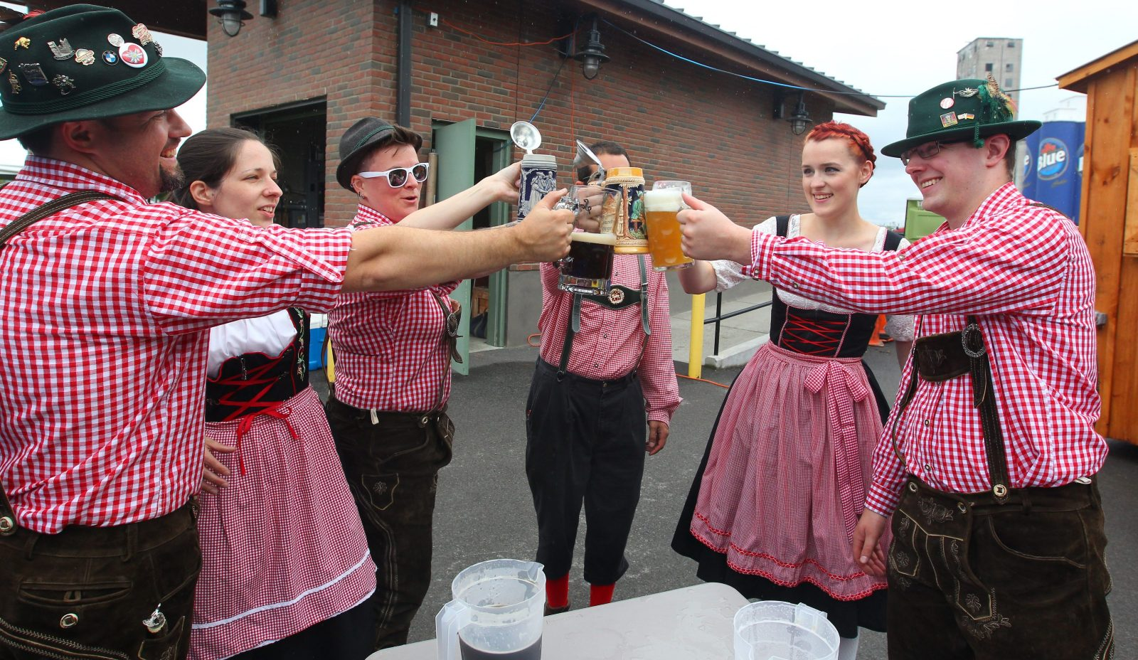 Members of the German-American Musicians Association raise a glass during Wurstfest in 2015. The festival returns to River Fest Park on June 26. (Mark Mulville/Buffalo News file photo)