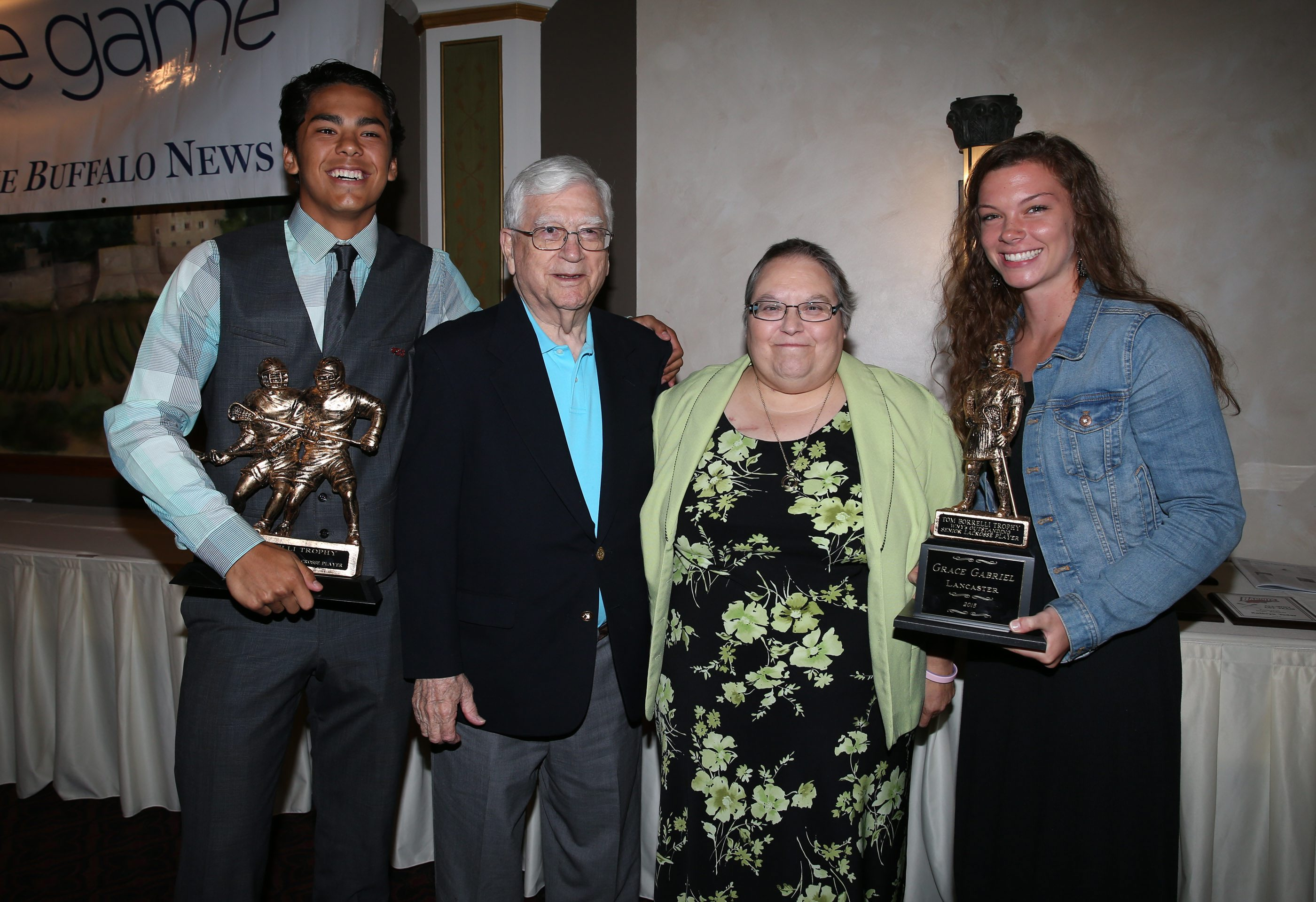 2015 Borrelli Award winners Larson Sundown of Akron (far left) and Grace Gabriel of Lancaster (far right) pose with George Borrelli (Tom's father) and Karen Borrelli (Tom's widow) at last year's banquet. (James P. McCoy/ Buffalo News)