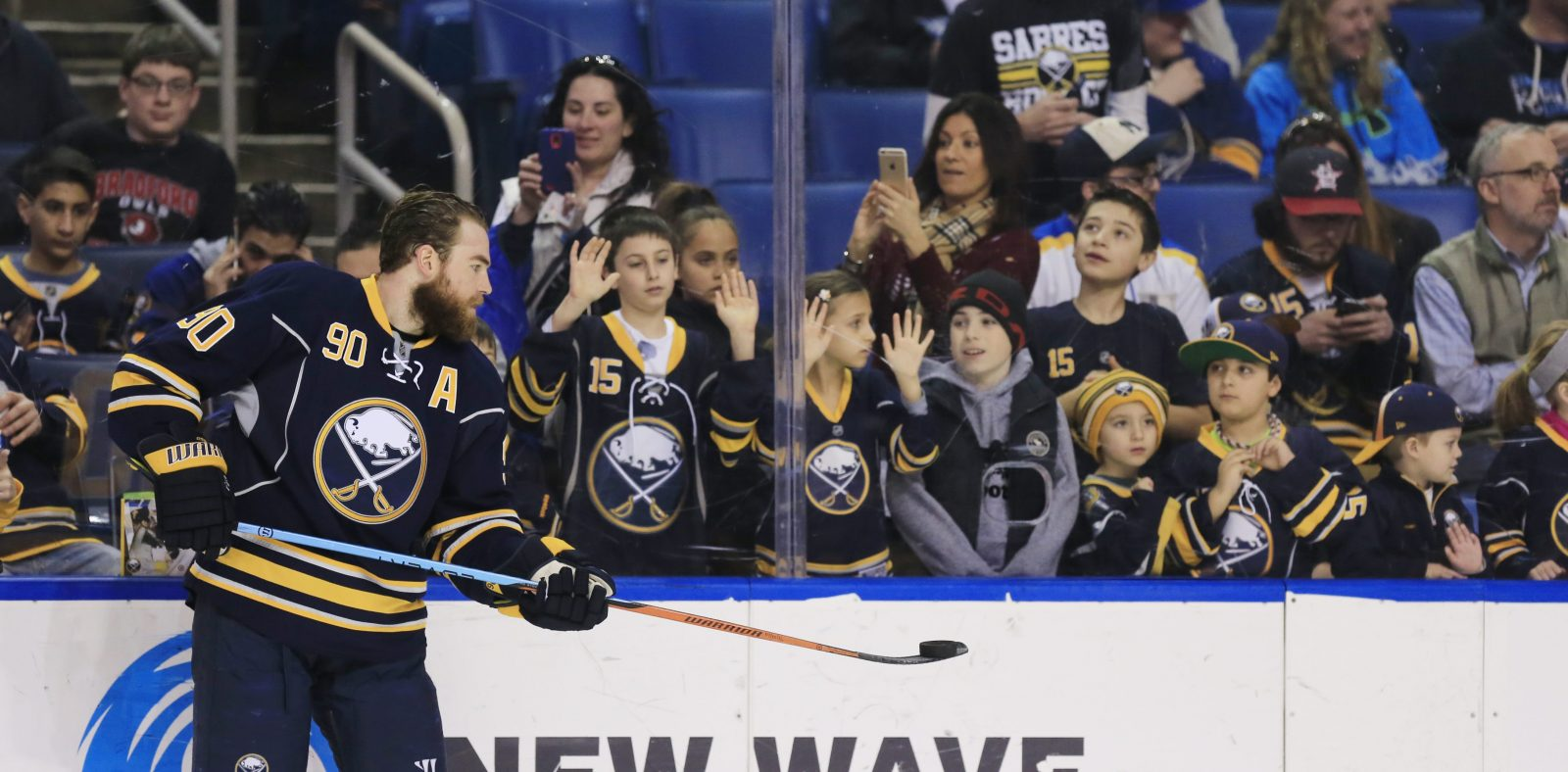 Buffalo Sabres Ryan O'Reilly tosses a puck to fans during pregame prior to playing the Winnipeg Jets at the First Niagara Center on Saturday, March 26, 2016. (Harry Scull Jr./Buffalo News)