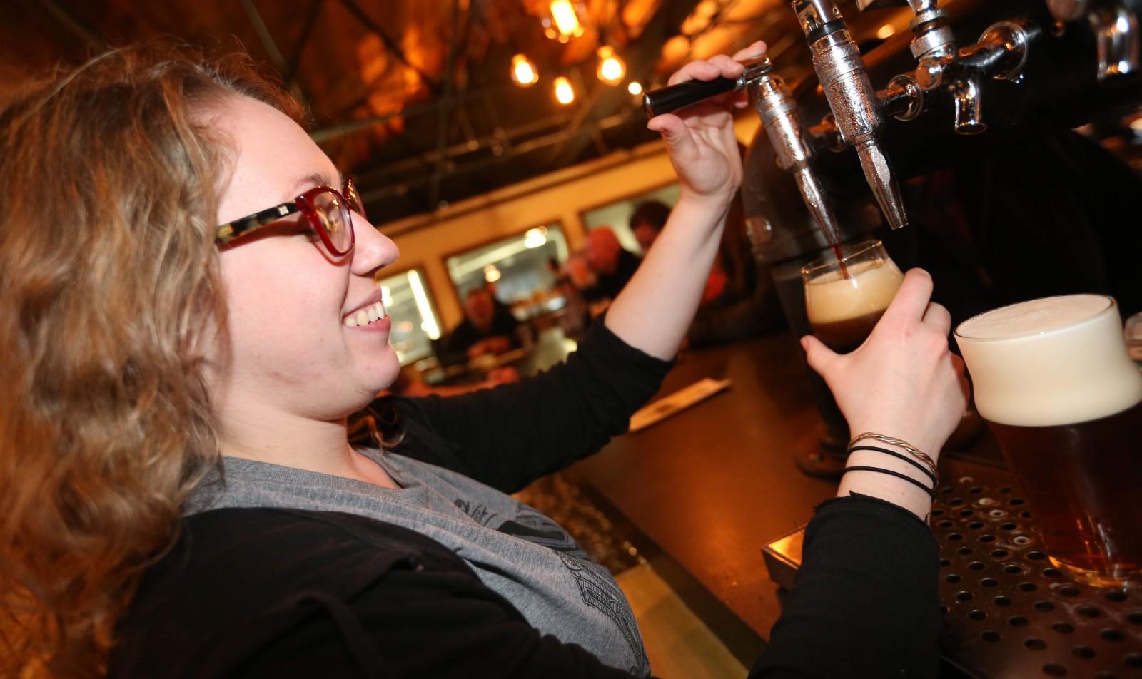 Bartender Kim Floyd pours a Nitro Elm Street Coffee Porter at 42 North Brewing Company.   (Sharon Cantillon/Buffalo News)