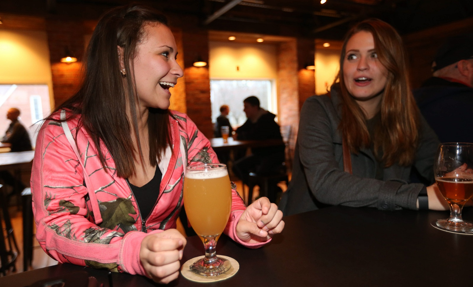Jackie Rosa, left of West Seneca, enjoys a Wallonia Wit at 42 North Brewing Company as she hangs out with her friend Katie Krempholtz, of Wales. (Sharon Cantillon/Buffalo News)