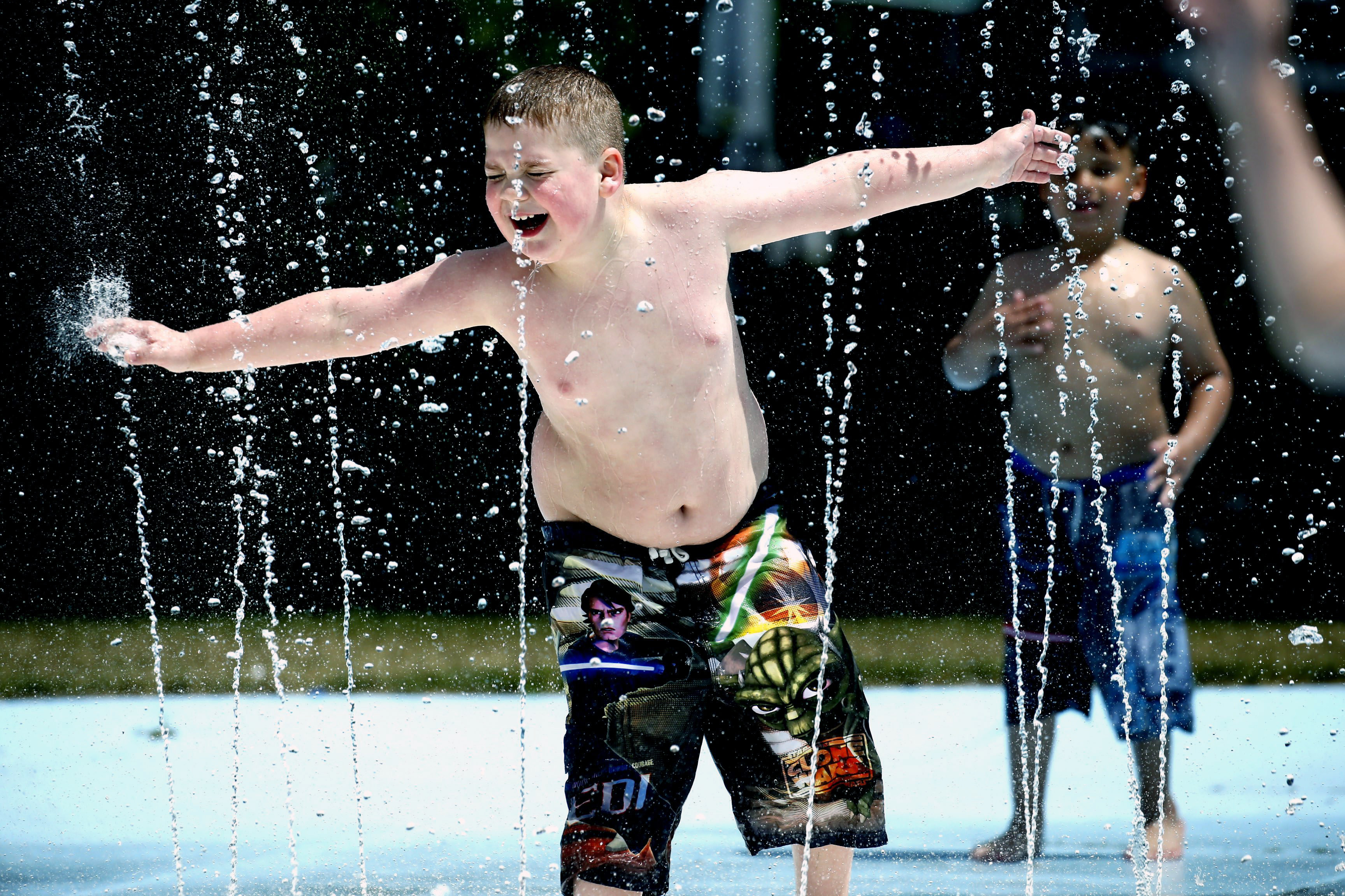 Braden Diebel, 8, enjoys the refreshing fountain of water at the Lasalle Park splash pad in Buffalo on Monday, May 30, 2016.  (Robert Kirkham/Buffalo News)