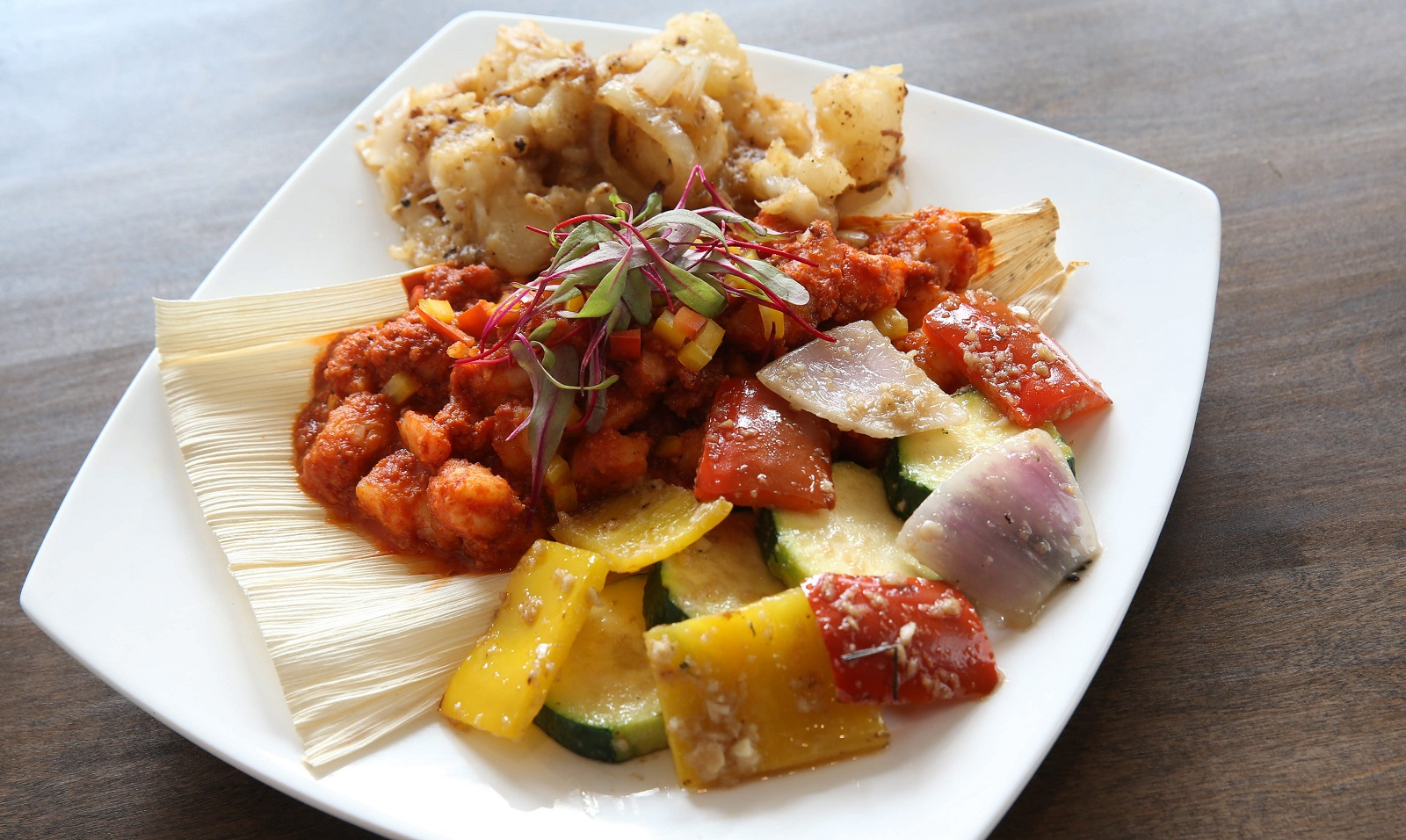 Cuban-style shrimp etoufee accompanies seasonal vegetables and yuca or two other sides of choice. (Sharon Cantillon/Buffalo News)