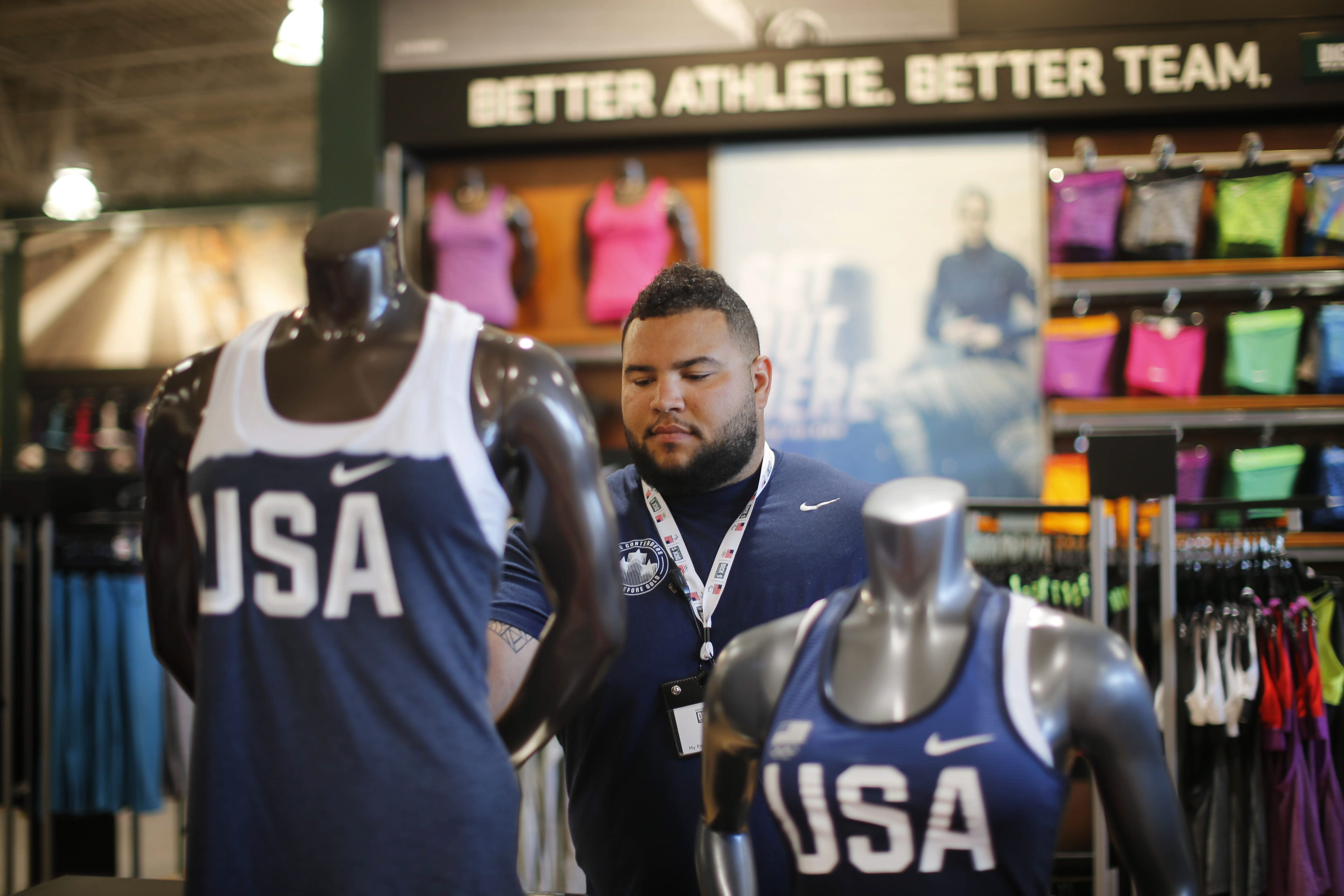 Shot-putter Jon Jones, formerly a UB standout, works at Dicks Sporting Goods at the Boulevard Mall while training to make the U.S. Olympic team as part of a program Ricks has for aspiring athletes, Tuesday, June 7, 2016. (Derek Gee/Buffalo News)