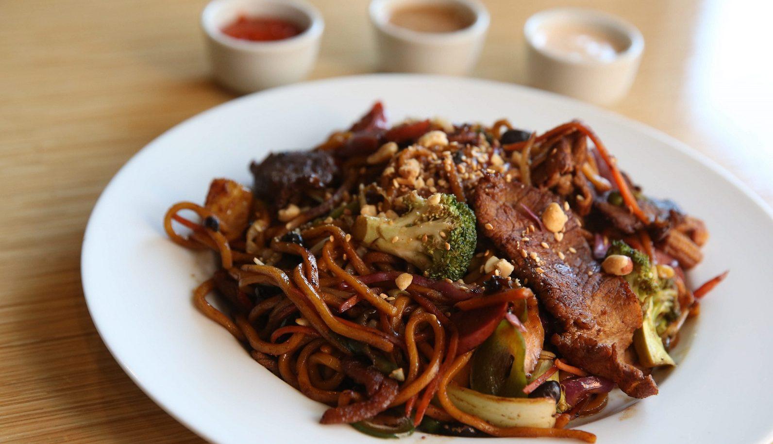 Shogun Teriyaki with meat, vegetables, lo mein noodles, garlic, red wine vinegar, shogun teriyaki sauce and Korean barbecue sauce.  (Sharon Cantillon/Buffalo News)