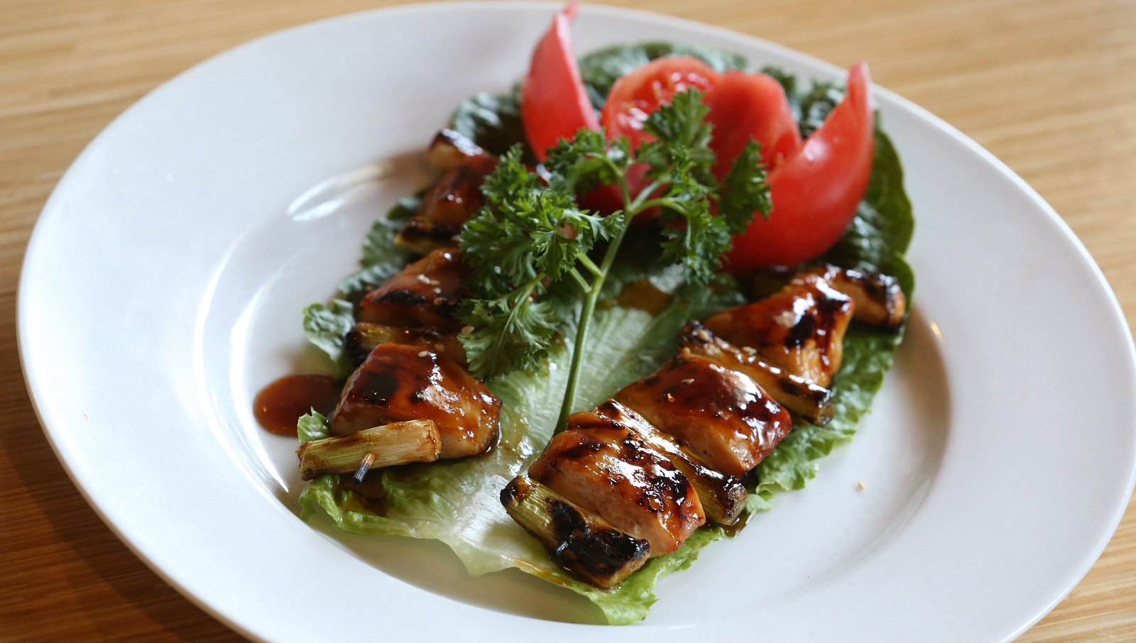 The Yakitoi appetizer is two skewers of barbecue chicken. (Sharon Cantillon/Buffalo News)