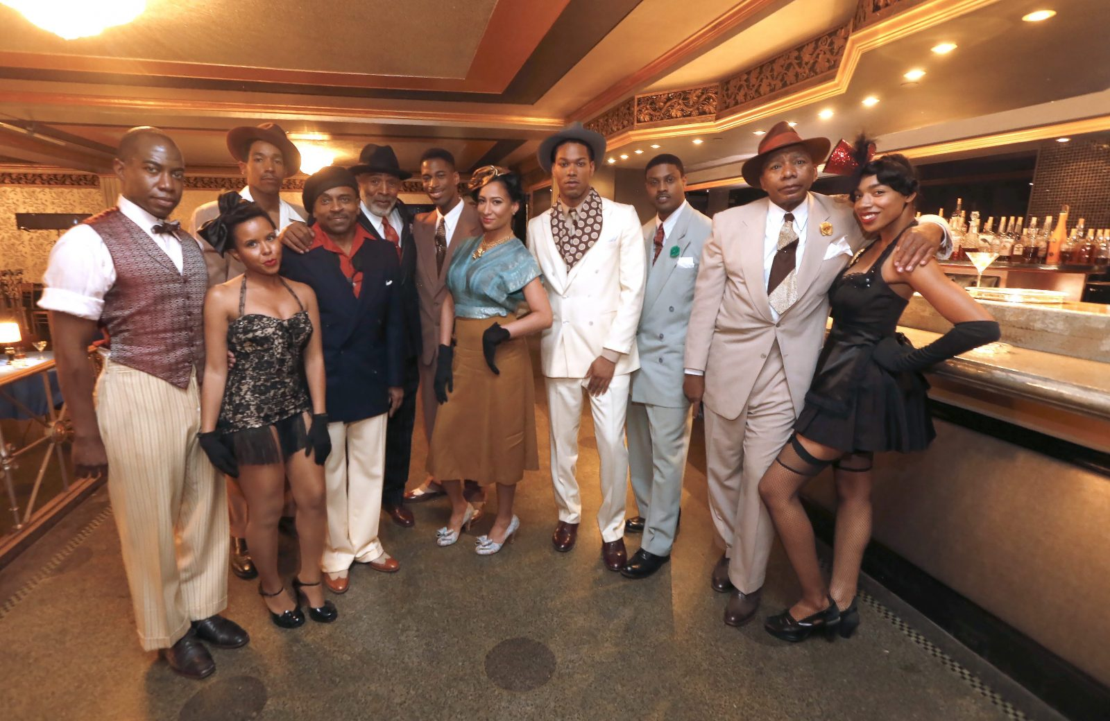 Some of the local extras visit between takes. The Hollywood crews turned the Statler's Rendezvous Room into the famed Milton's Play House in 1941 Harlem and were filming there all day today, Wednesday, June 8, 2016. (Robert Kirkham/Buffalo News)