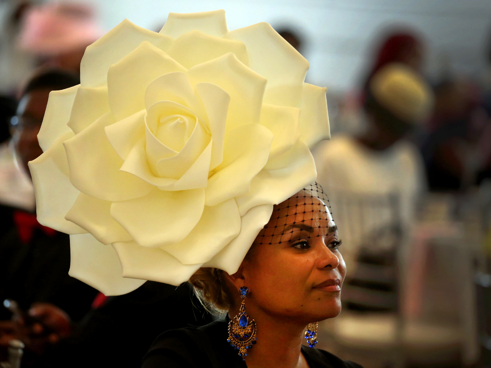 Toni Vazquez with a floral hat at the Mother, Daughter, Sister, Friend Tea, dressed-up for the African-American Cultural Center the center's biggest fundraiser Lafayette Hotel in Buffalo, N.Y., on Sunday June 12, 2016. (John Hickey/Buffalo News)