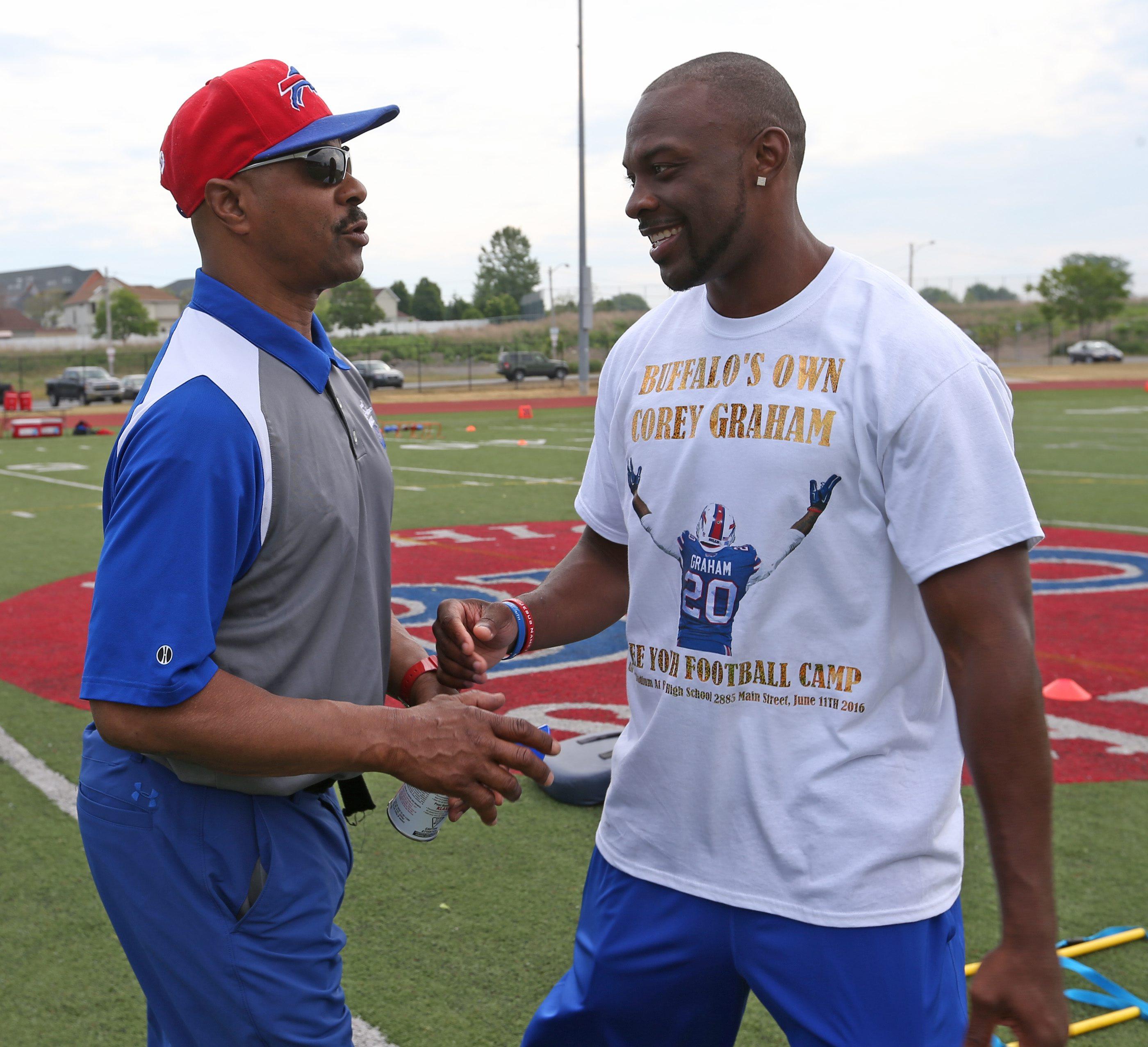 Corey Graham runs a free football camp along with his high school coach Willie Burnett at Robert E Rich Sr. All High Stadium in Buffalo, NY on Saturday,June 11, 2016.  (James P. McCoy/ Buffalo News)