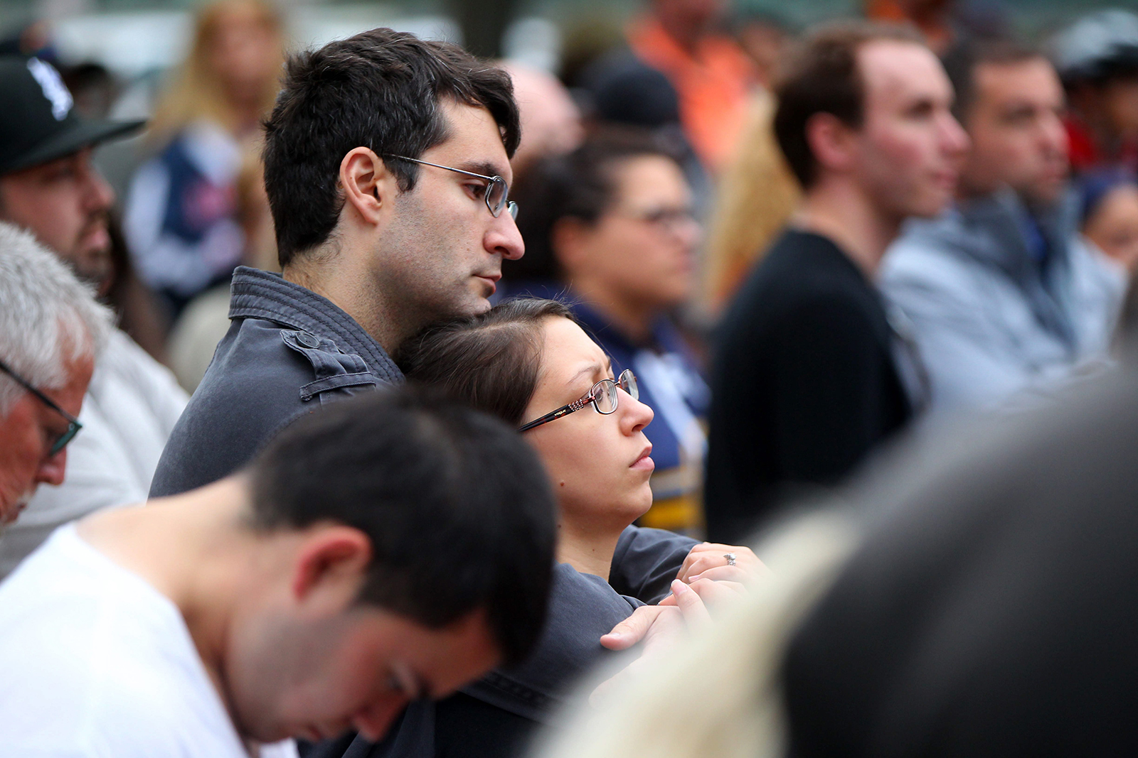 James and Shannon Poupalos listen to the speakers duirng a vigil in Niagara Square in Buffalo Monday, June 11, 2016, in support of those killed in Orlando over the weekend. (Mark Mulville/Buffalo News)
