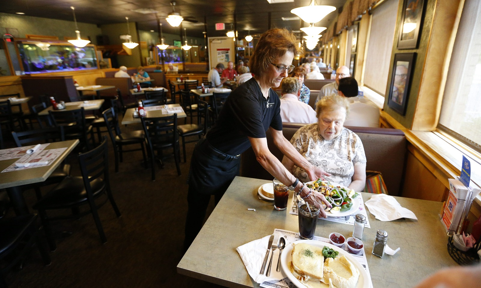 Server Judy Rohloff serves her mom and customer Pat Rohloff at Mister Dee's in Cheektowaga. (Mark Mulville/Buffalo News)