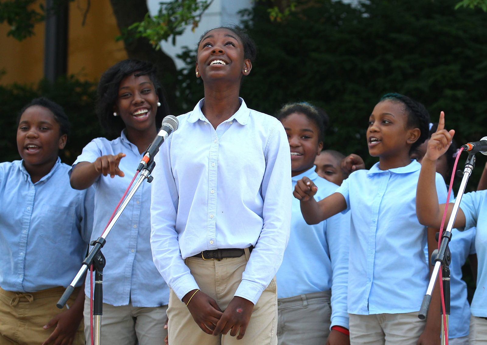 Timzania Chatman, center, and the Westminster Community Charter School Chorus performs during the M&T Bank Summer Concert Series at Fountain Plaza in Buffalo Tuesday, June 14, 2016. The chorus was doing selections from Beauty and the Beast. (Mark Mulville/Buffalo News)