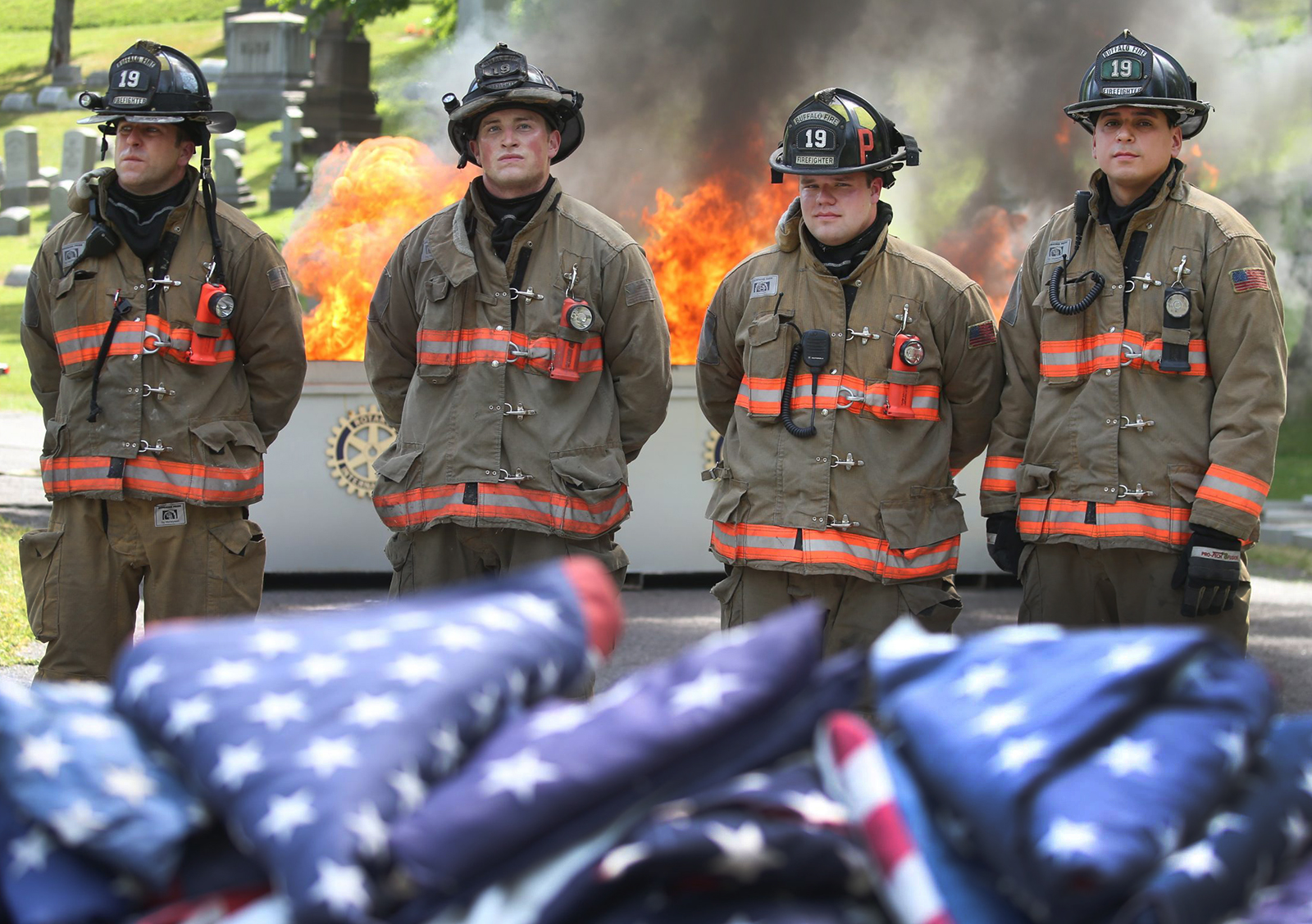 Buffalo Fireman from Engine 39 were on hand to burn old flags in the proper manner of disposal, on the 100th Anniversary of Flag Day, at Forest Lawn Cemetery , in Buffalo, N.Y.,on Tuesday June 14, 2016and the Buffalo Fire Dept. crew from Engine 19 helped out with the retirement of old flags by burning them. (John Hickey/Buffalo News)