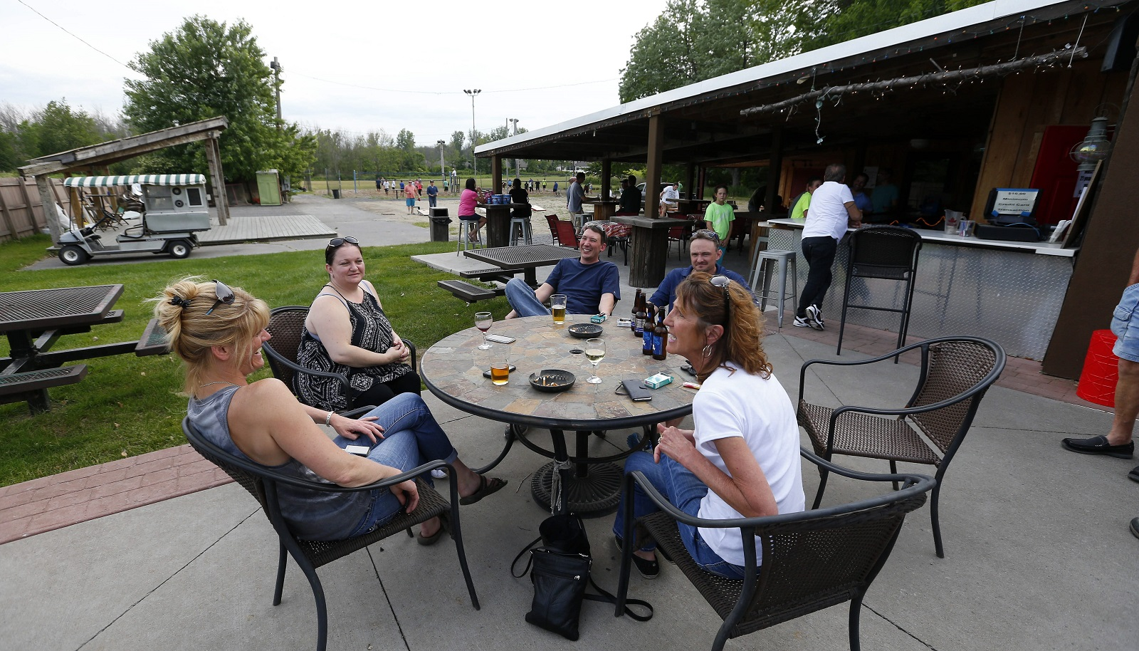 People enjoy the outdoor patio at the Angry Buffalo at the Rose Garden in Williamsville. (Mark Mulville/Buffalo News)