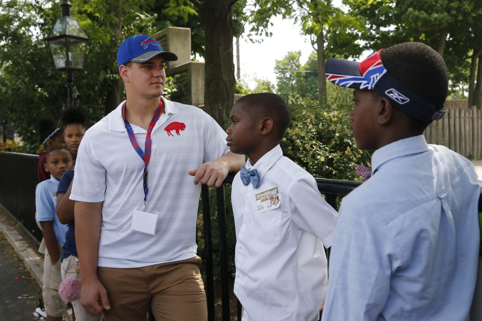 Buffalo Bills rookie fullback Glenn Gronkowski and Westminster Community Charter School fifth graders Chase Welch, center, and James Glover, right, check, out the Asian elephants during a visit to The Buffalo Zoo as part of the NFL's Rookie Transition Program on Monday.  (Derek Gee/Buffalo News)