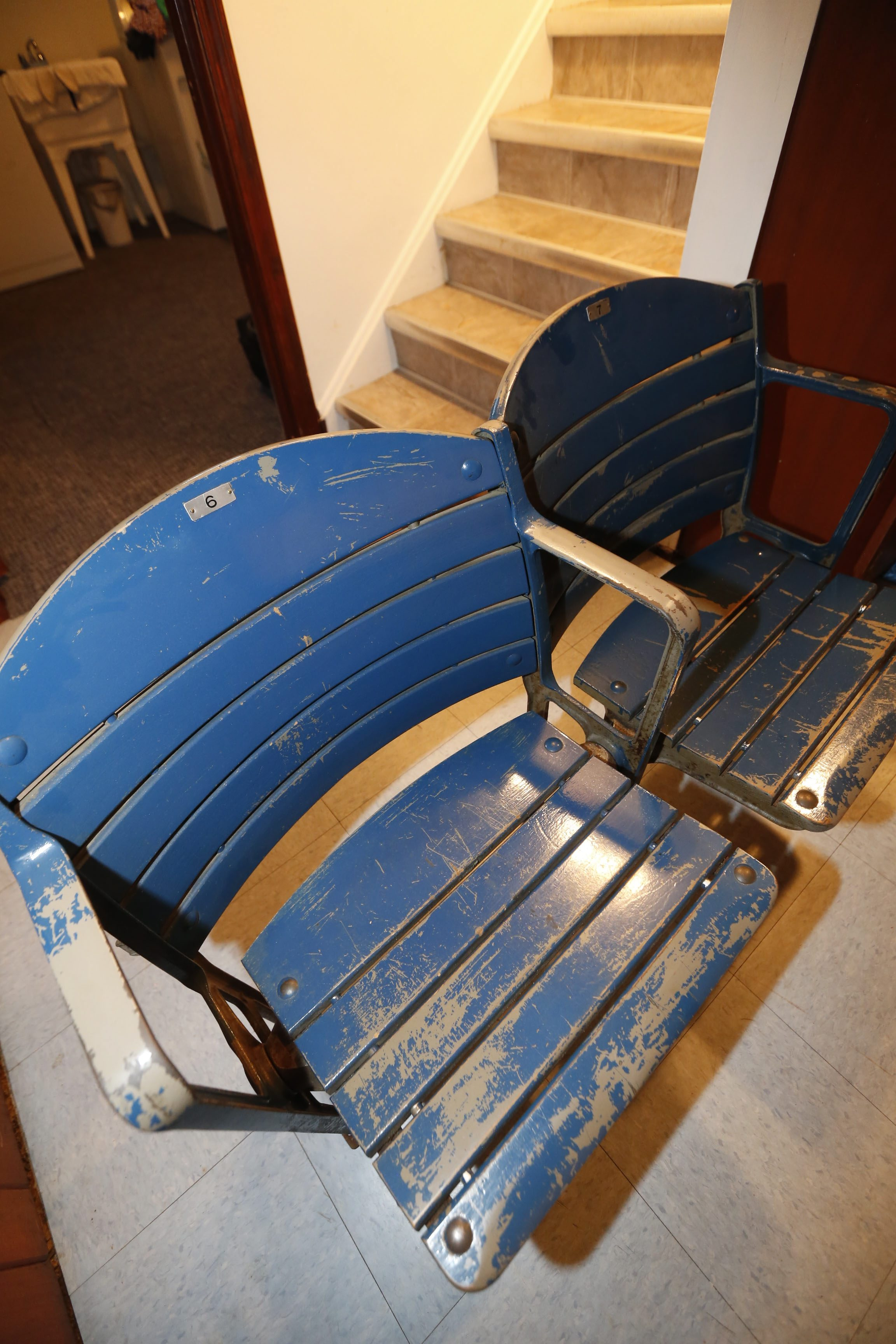 Seats from Memorial Auditorium that were gray and painted blue to attract higher ticket prices. (Robert Kirkham/Buffalo News)