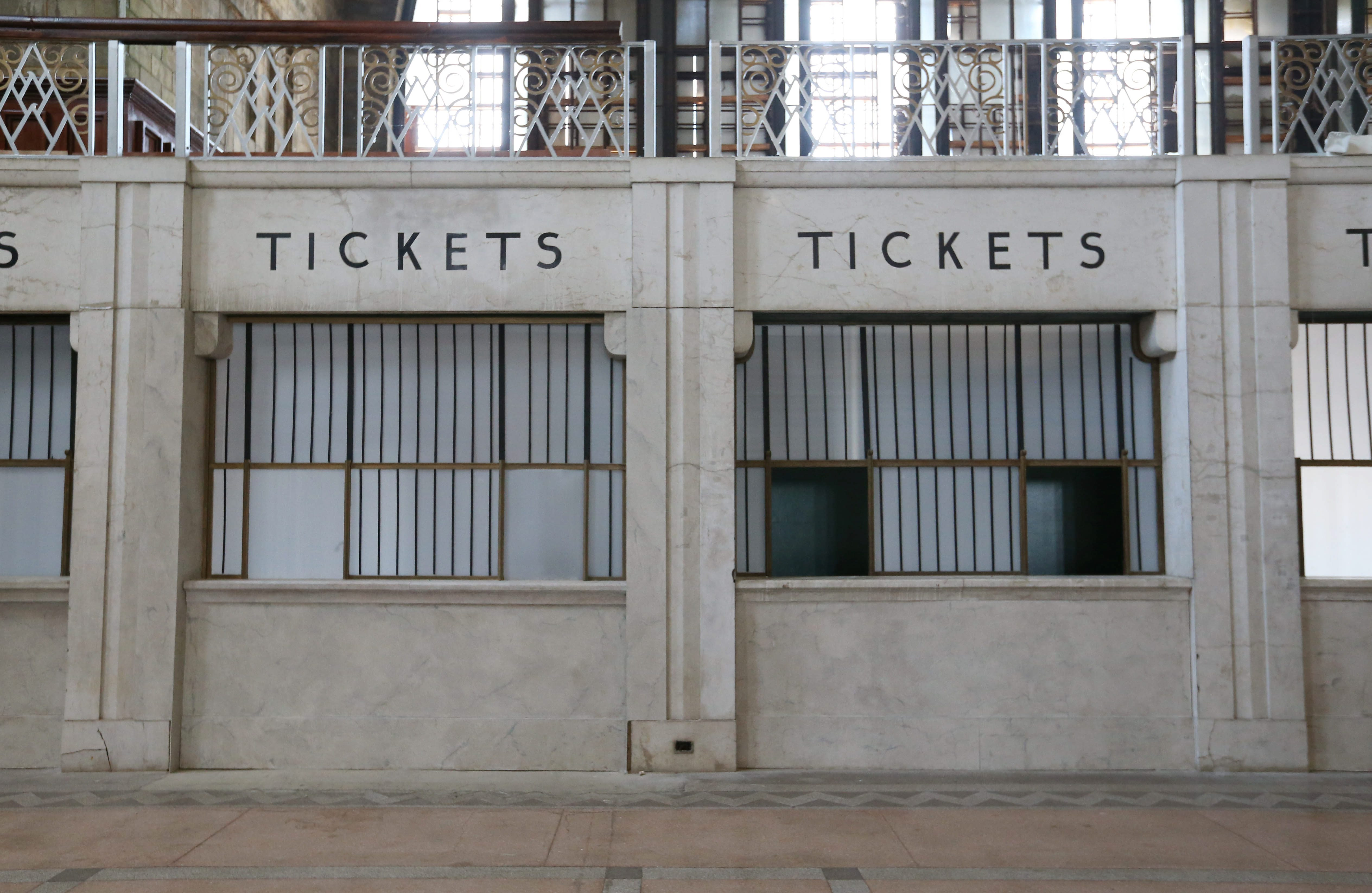 """Which is real and which is fake? The front half of the Central Terminal got a cosmetic makeover for one day of filming of the movie """"Marshall."""" On the right is an original ticket counter and on the left is a cosmetically restored one. (Sharon Cantillon/Buffalo News)"""