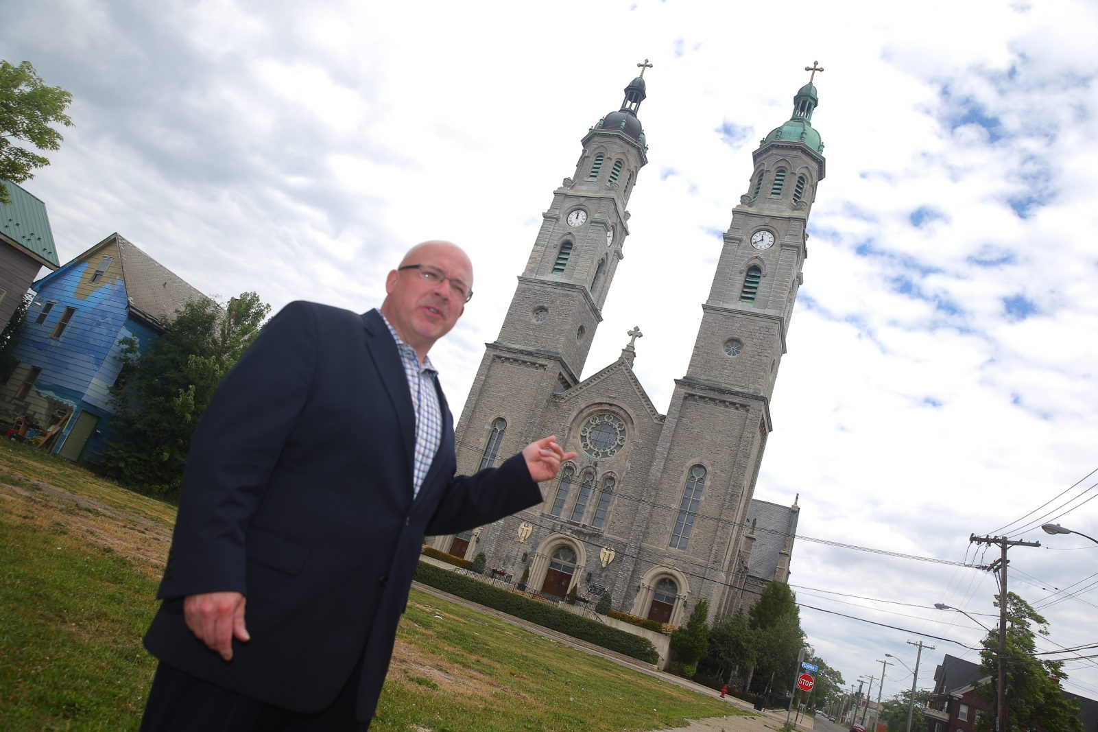 James L. Lawicki, president of the Polish American Congress, came up with the idea for the Polonia Trail. He's seen here in front of St. Stanislaus Church. (John Hickey/Buffalo News)