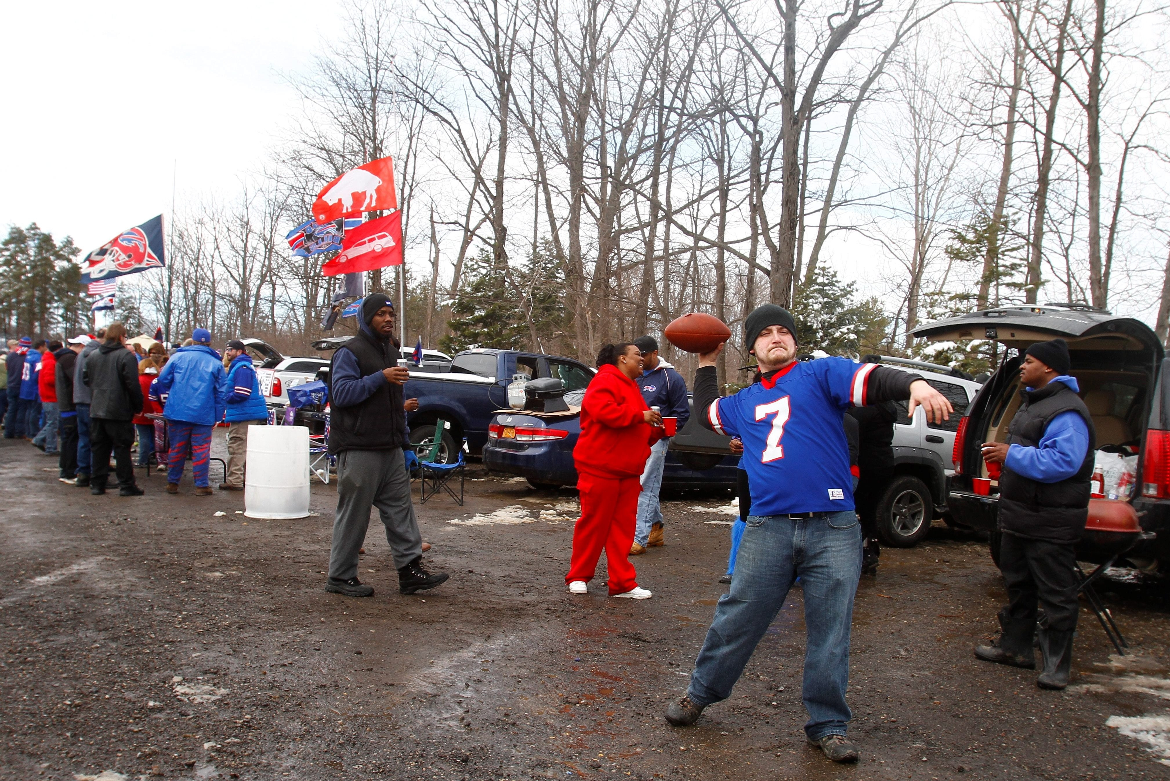 Bills fans throw the football and play catch in a parking lot on California Road in Orchard Park. (News file photo)