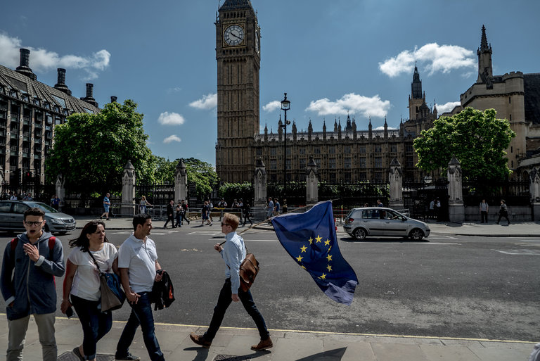 Friday, outside the Houses of Parliament. (New York Times)
