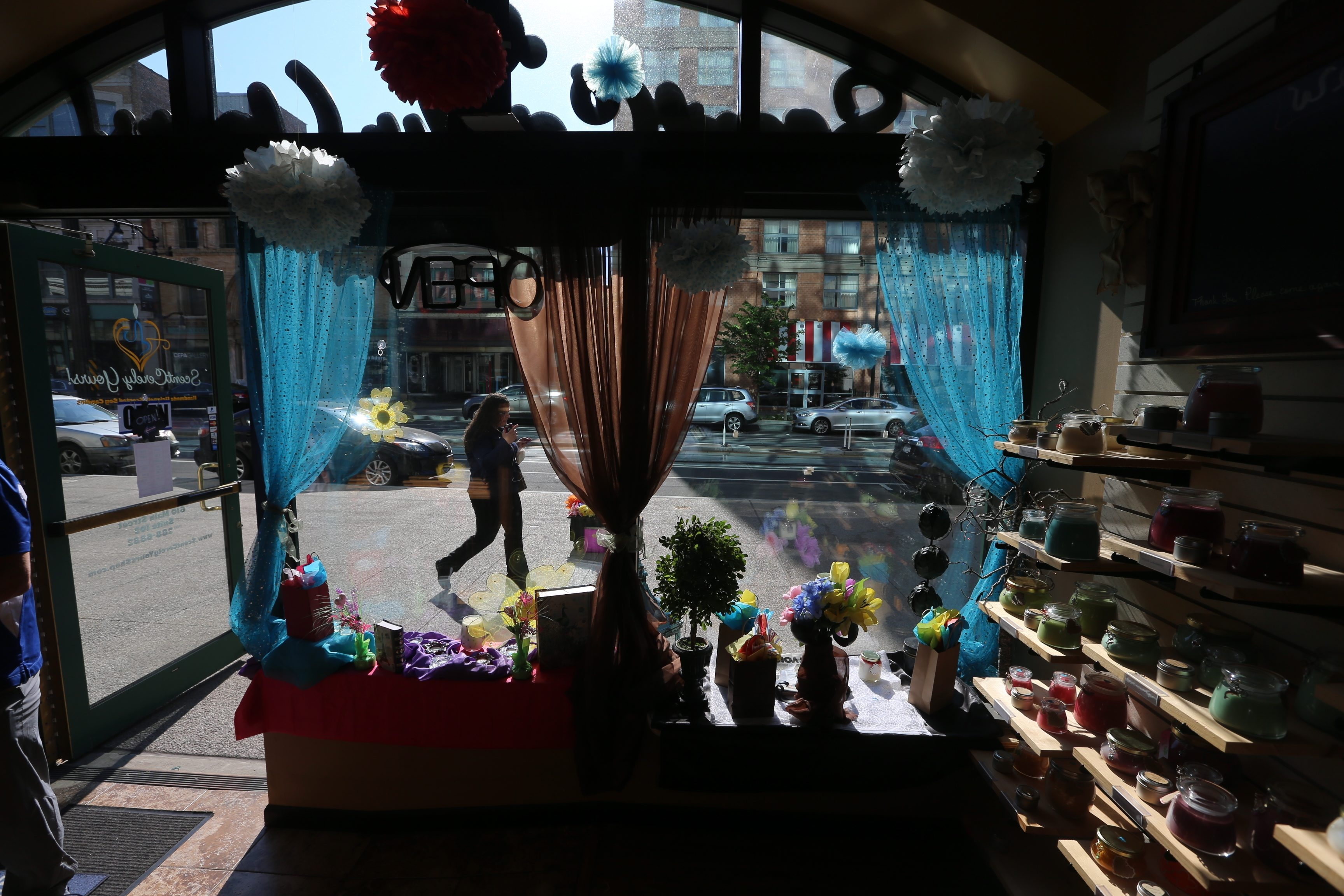 """The owners of ScentCerely Yours candle shop at 610 Main St., above, have put candle lanterns, sandwich boards and flower displays on the sidewalk to attract customers, who often stop in and say, """"Whoa! I didn't know you were here!"""""""