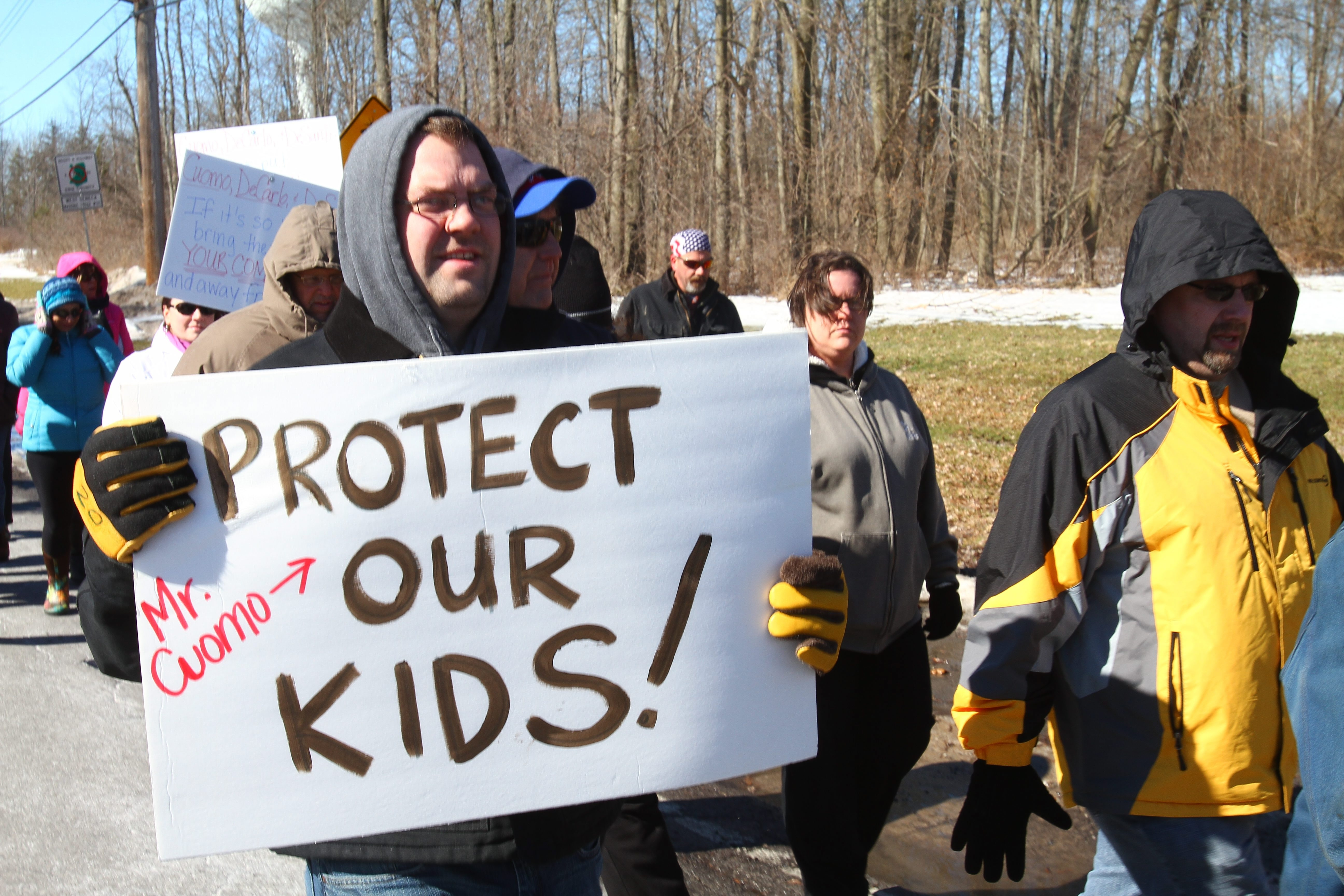 Residents marched on Leydecker Road, West Seneca, in protest over a group home housing sex offenders in February 2014.   (John Hickey / Buffalo News)