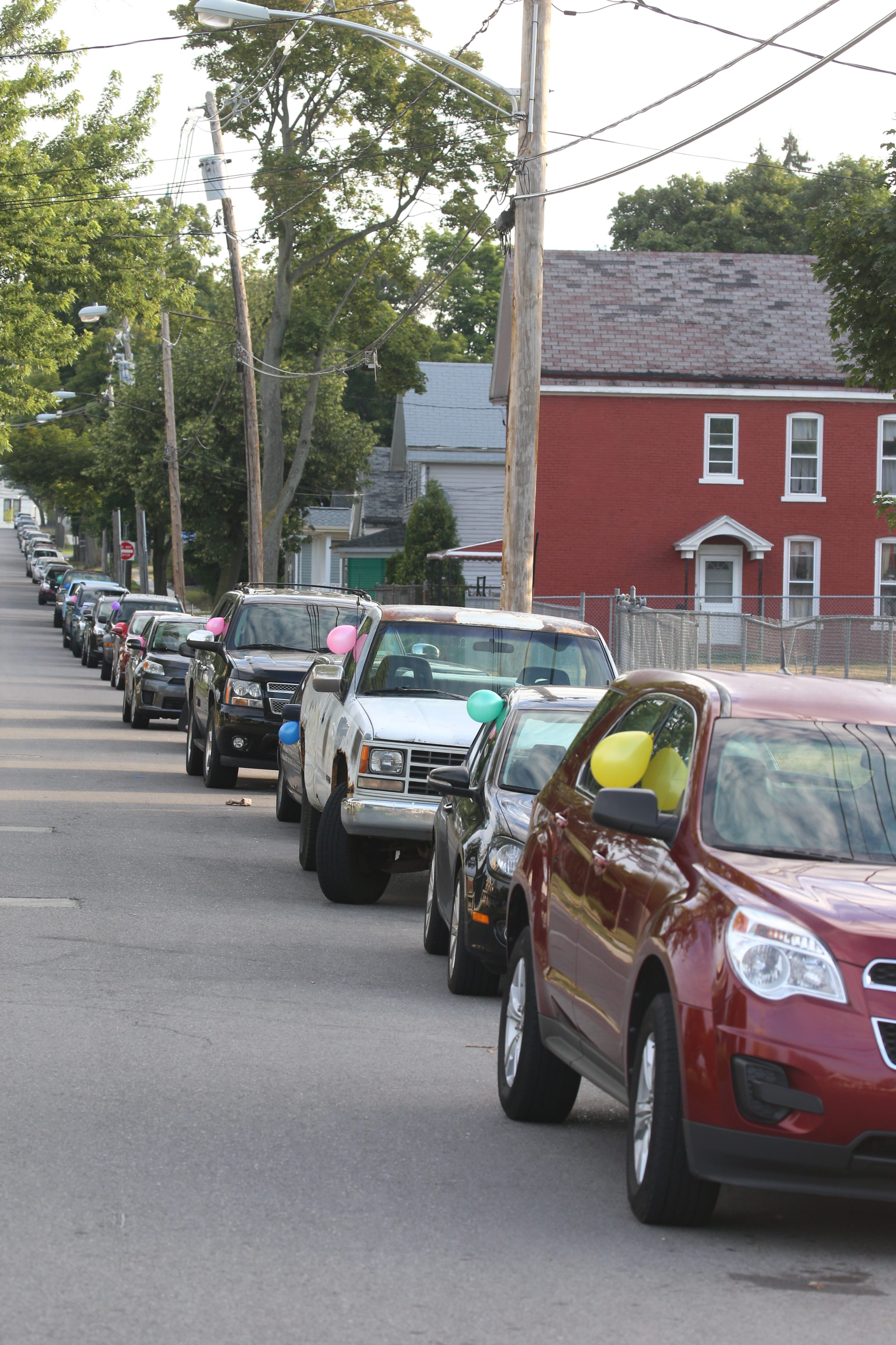 In August, Fruitbelt residents on Mulberry Street marked their vehicles with balloons and parked in parking spaces on the street to keep Medical Campus workers from parking in them as a protest. They argued that residents can't park on their own streets because the Buffalo Niagara Medical Campus won't provide parking for its workers. (John Hickey/Buffalo News)