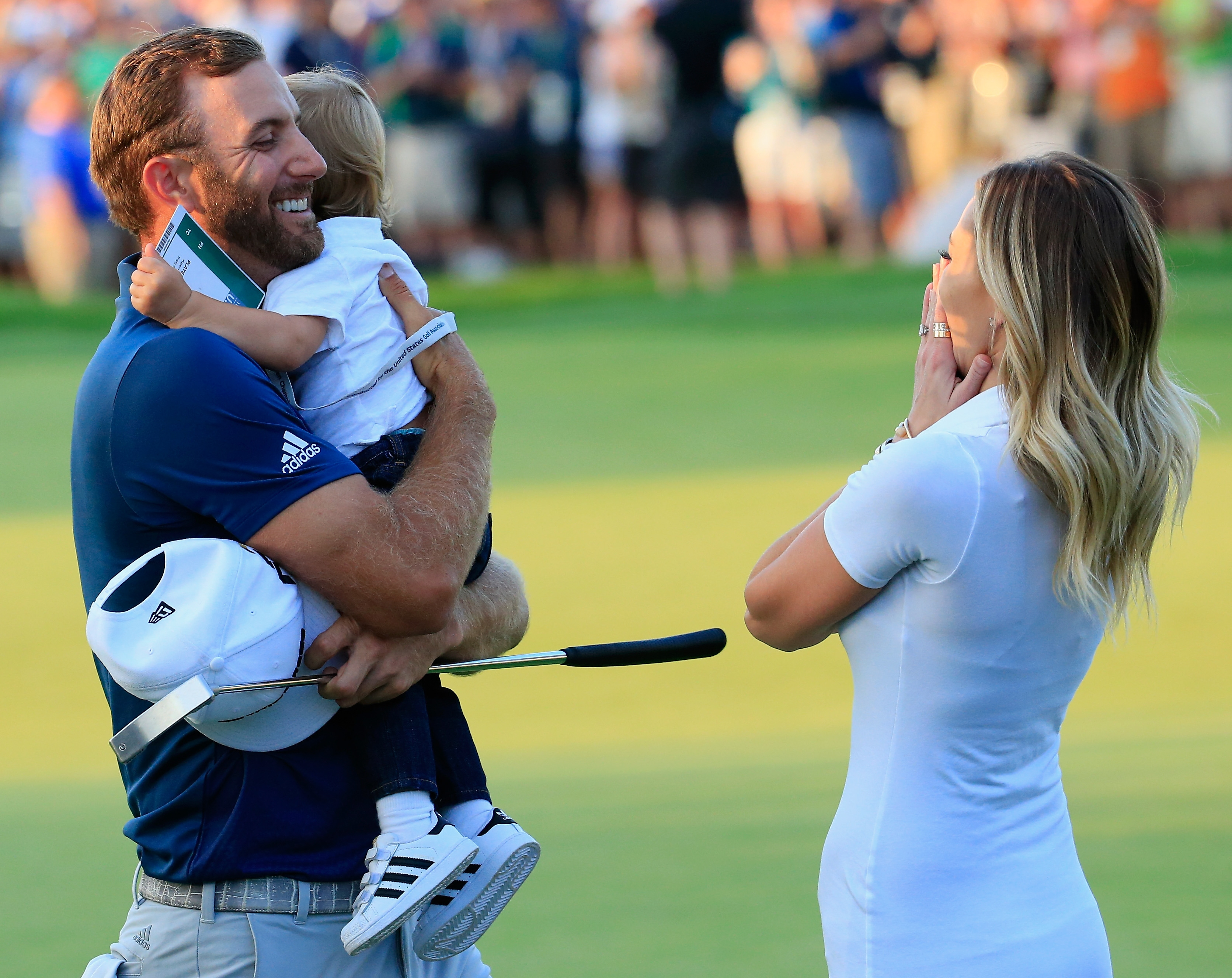 Dustin Johnson celebrates with partner Paulina Gretzky and their son Tatum after Johnson's win at Oakmont Country Club.