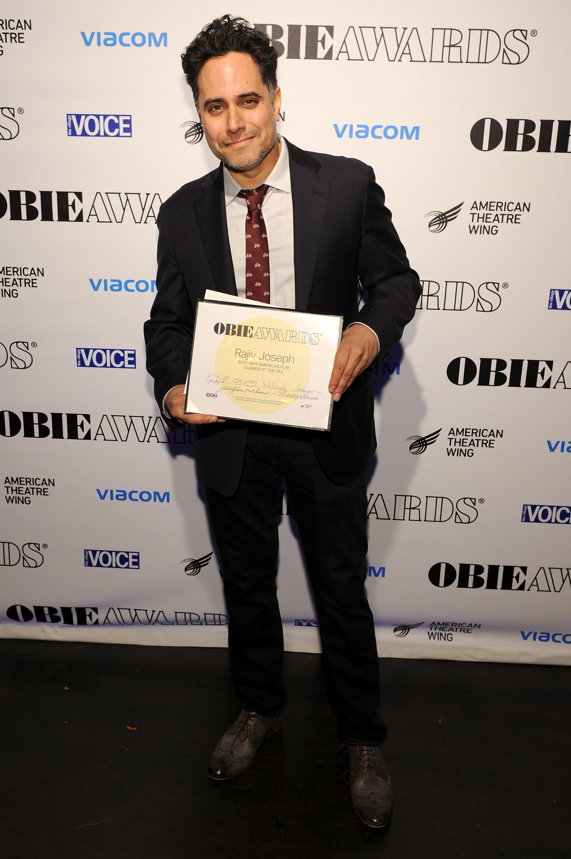 NEW YORK, NY - MAY 23:  Rajiv Joseph poses with  award at the 61st Annual Obie Awards at Webster Hall on May 23, 2016 in New York City.  (Photo by Craig Barritt/Getty Images for American Theater Wing)
