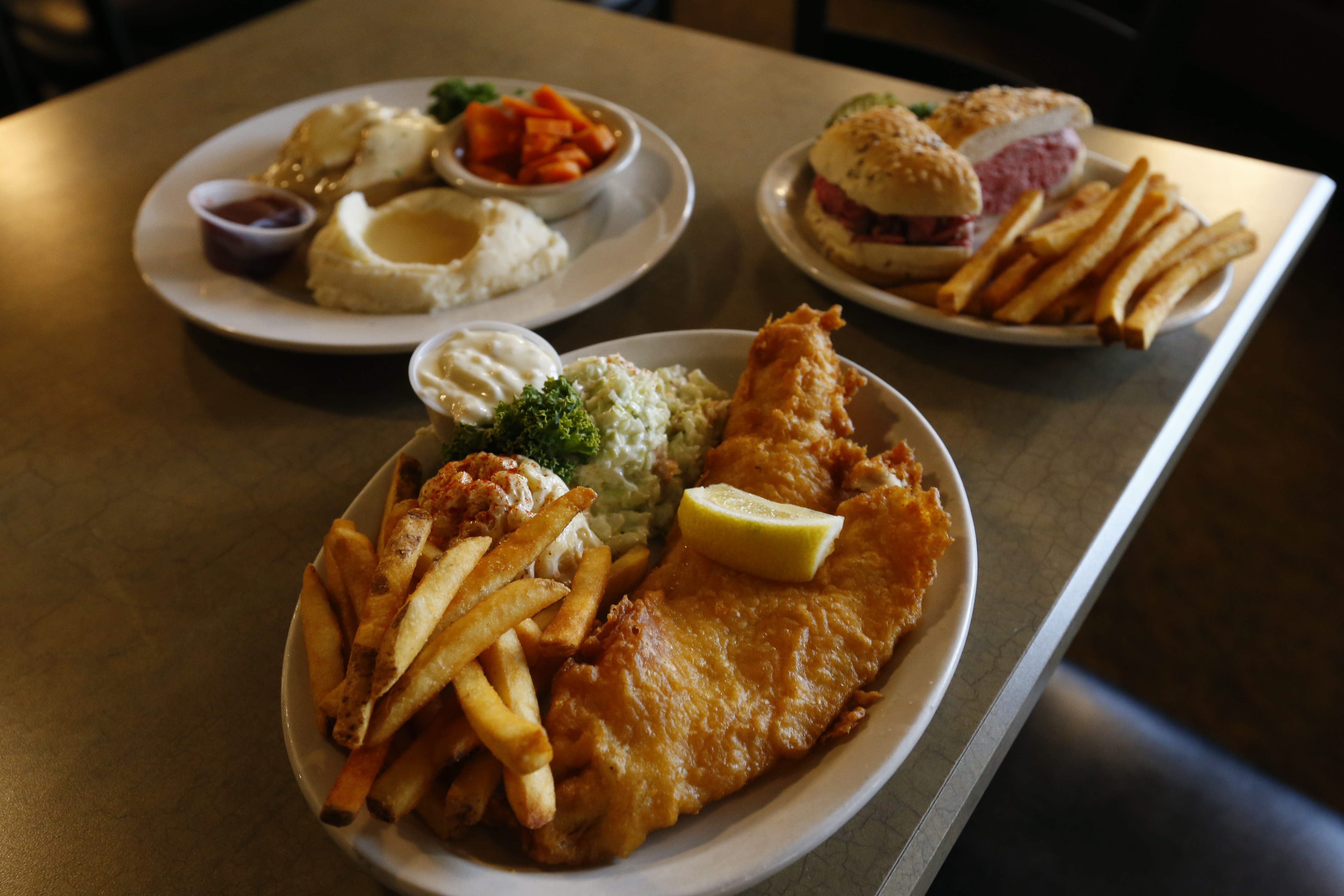 A fish fry, a beef on weck, and turkey and mashed potatoes at Mister Dee's in Cheektowaga Thursday, June 16, 2016.