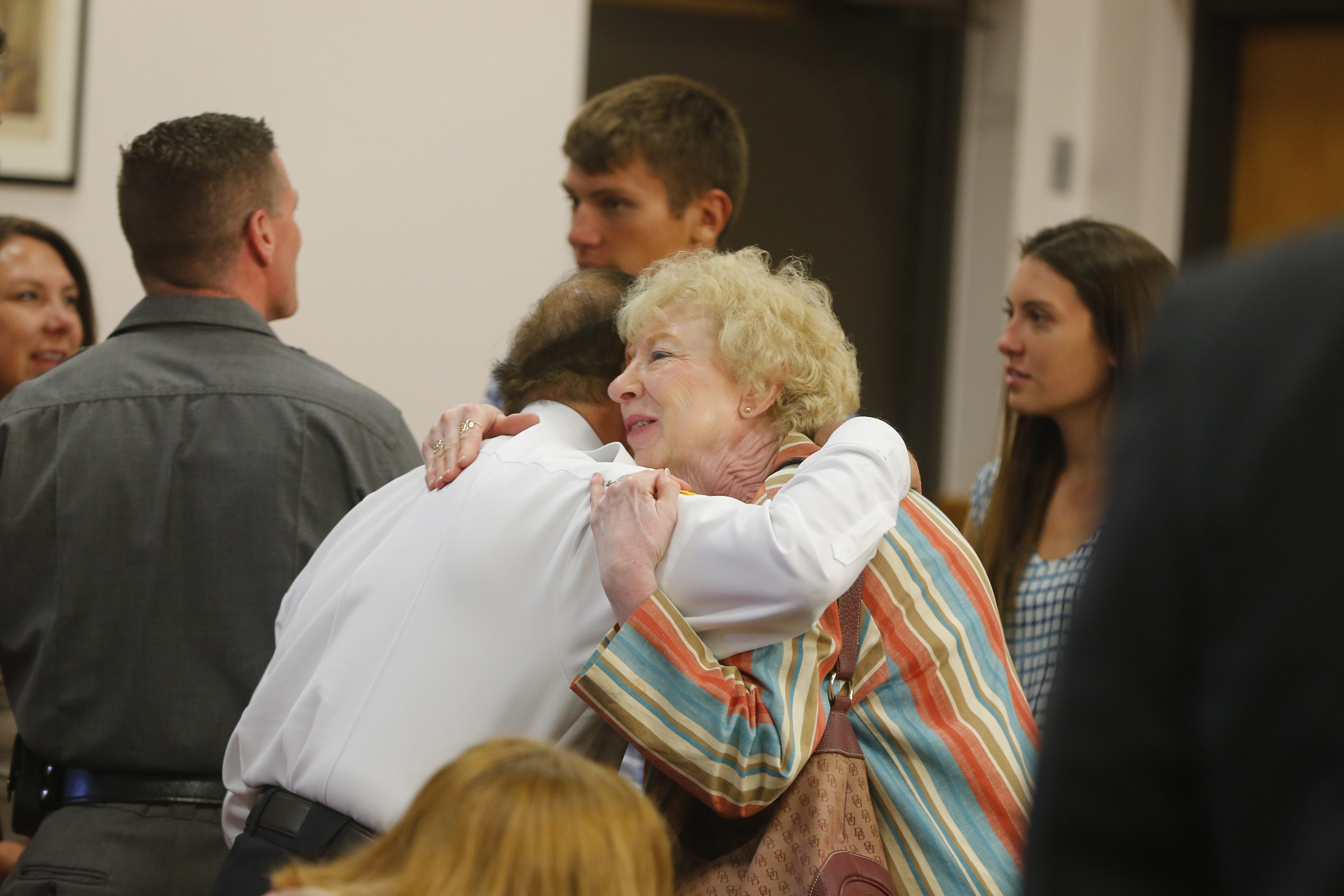 Evans Police Chief Ernest Masullo hugs Charlotte Moss, mother of Barry Moss, after a press conference at the Evans Town Hall on Tuesday. (Mark Mulville/Buffalo News)