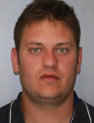 Brandon W. Benben, 26, faces two drug charges after he rolled his car over in Genesee County on Tuesday. (State Police)