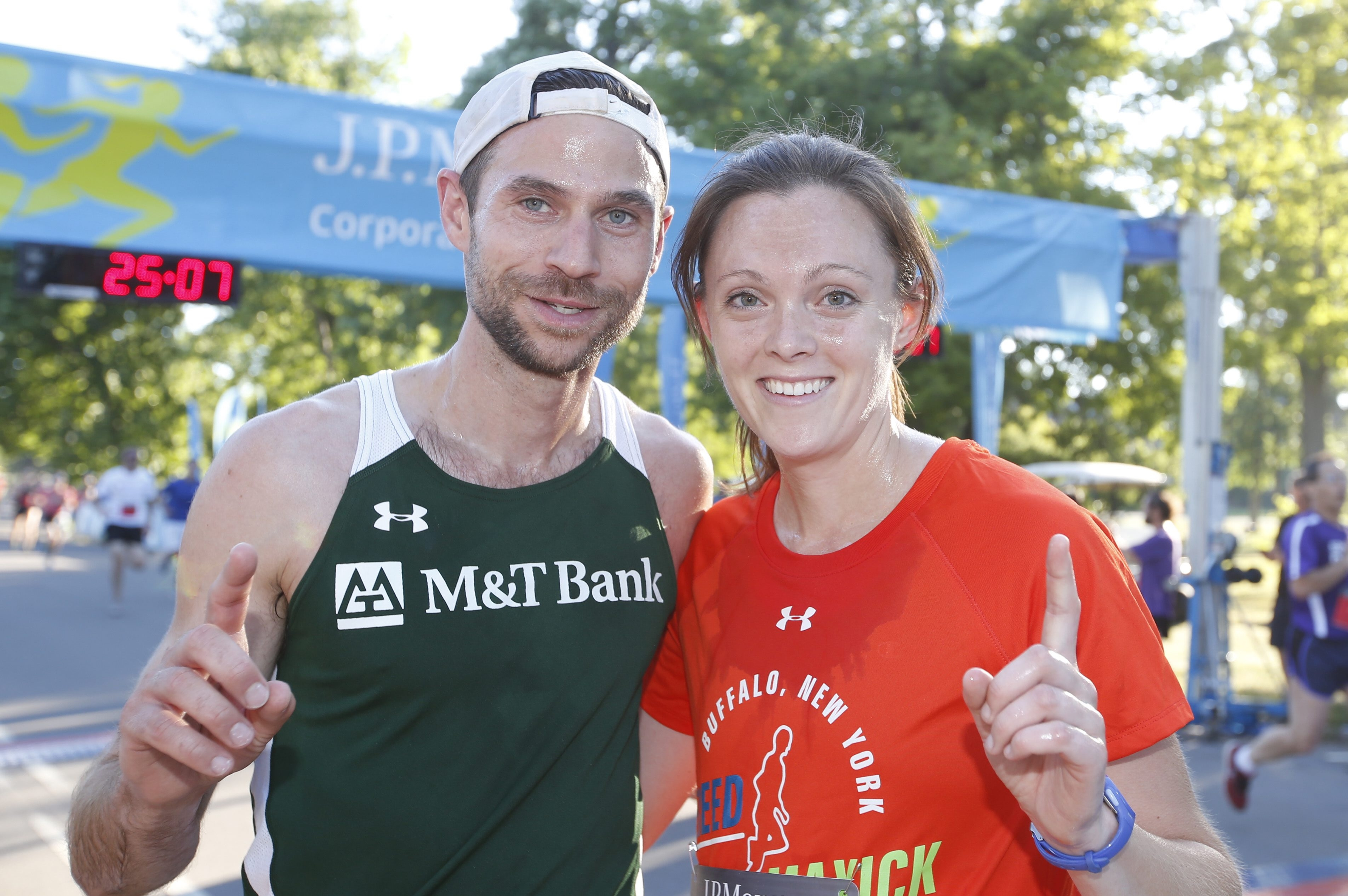 David Keenan and Kimberly Mills were the first male and female finishers in the J.P.Morgan Corporate Challenge Thursday.