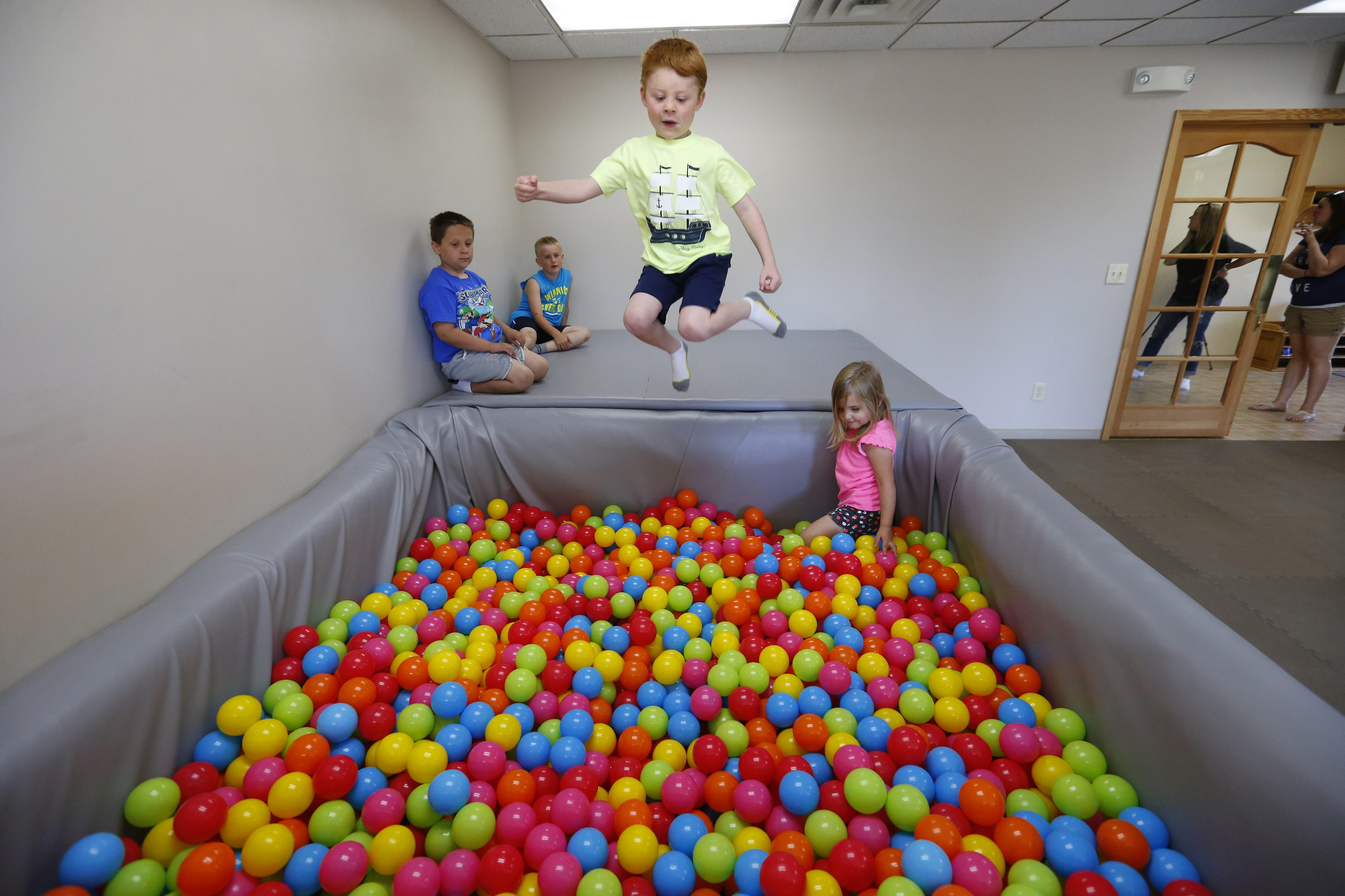 Joey Barile jumps into a pool of balls in the indoor play area at Sensational Fun in Orchard Park on Friday.    (Mark Mulville/Buffalo News)
