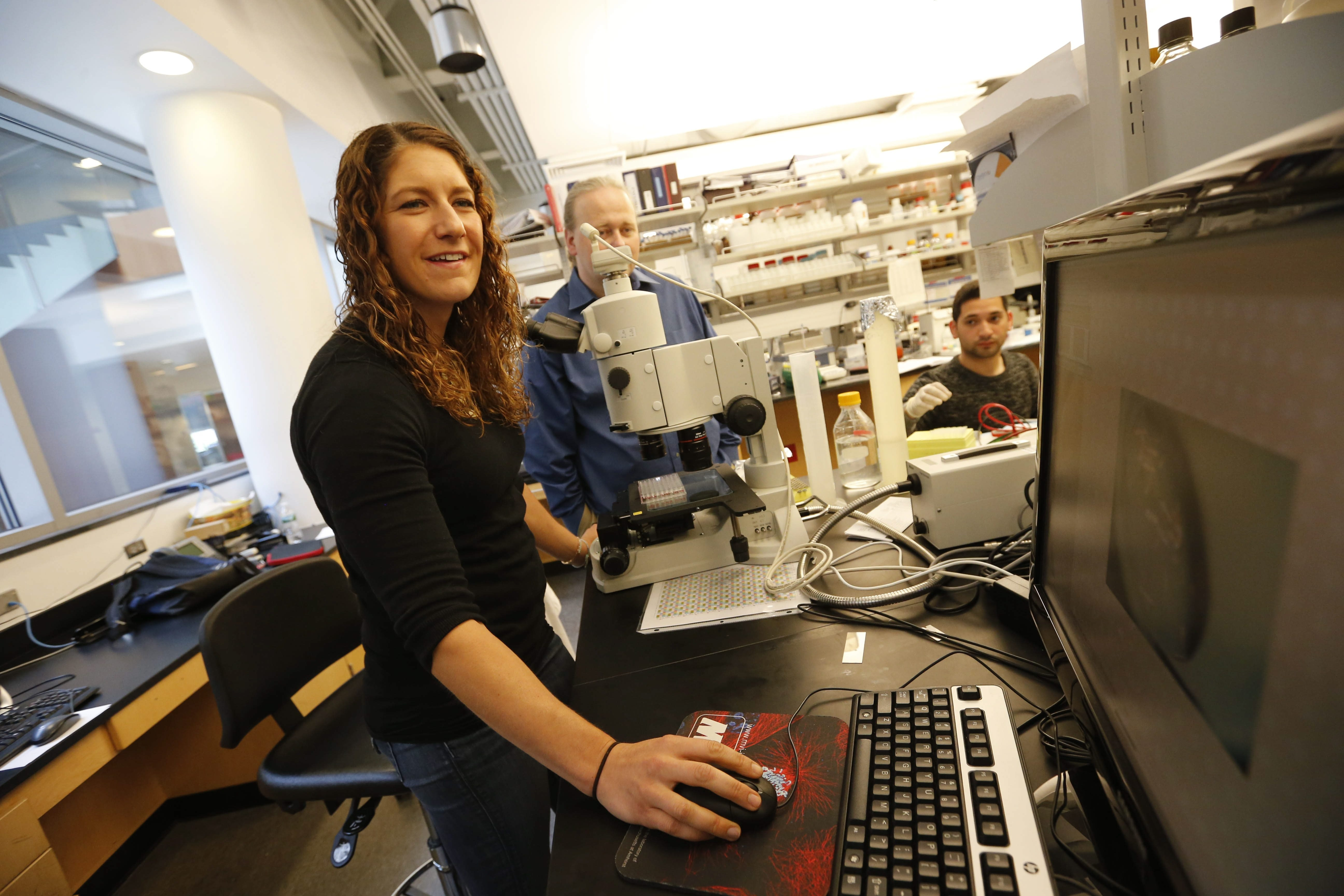 Kristin Sutton, senior project manager at HarkerBIO, works in the company's lab in the Hauptman-Woodward Medical Research Institute, Friday, June 17, 2016.  (Derek Gee/Buffalo News)