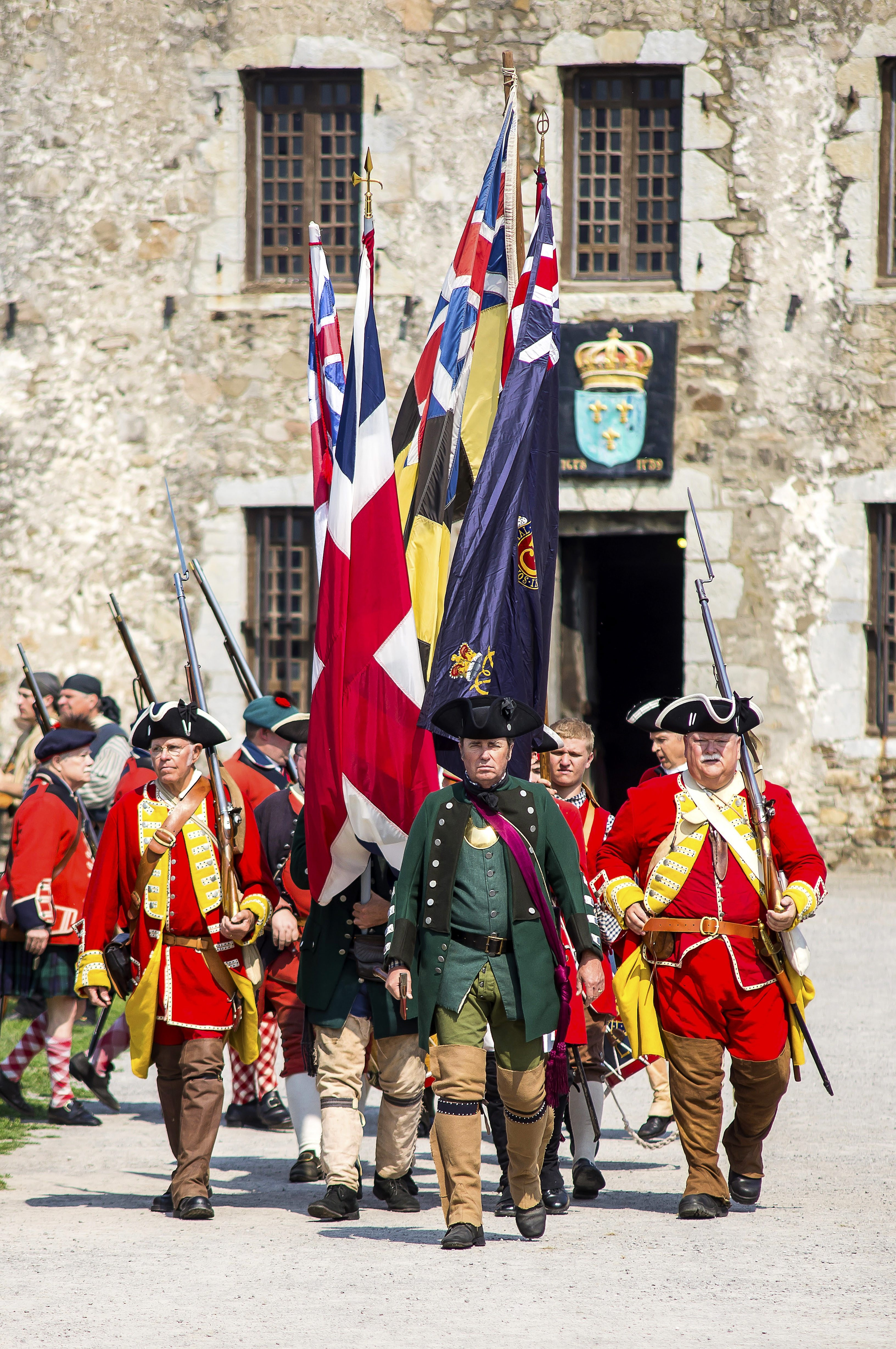 6 British troops make formation in front of Castle (Wayne Peters). Old Fort Niagara's French & Indian War Encampment for use in Niagara Weekend