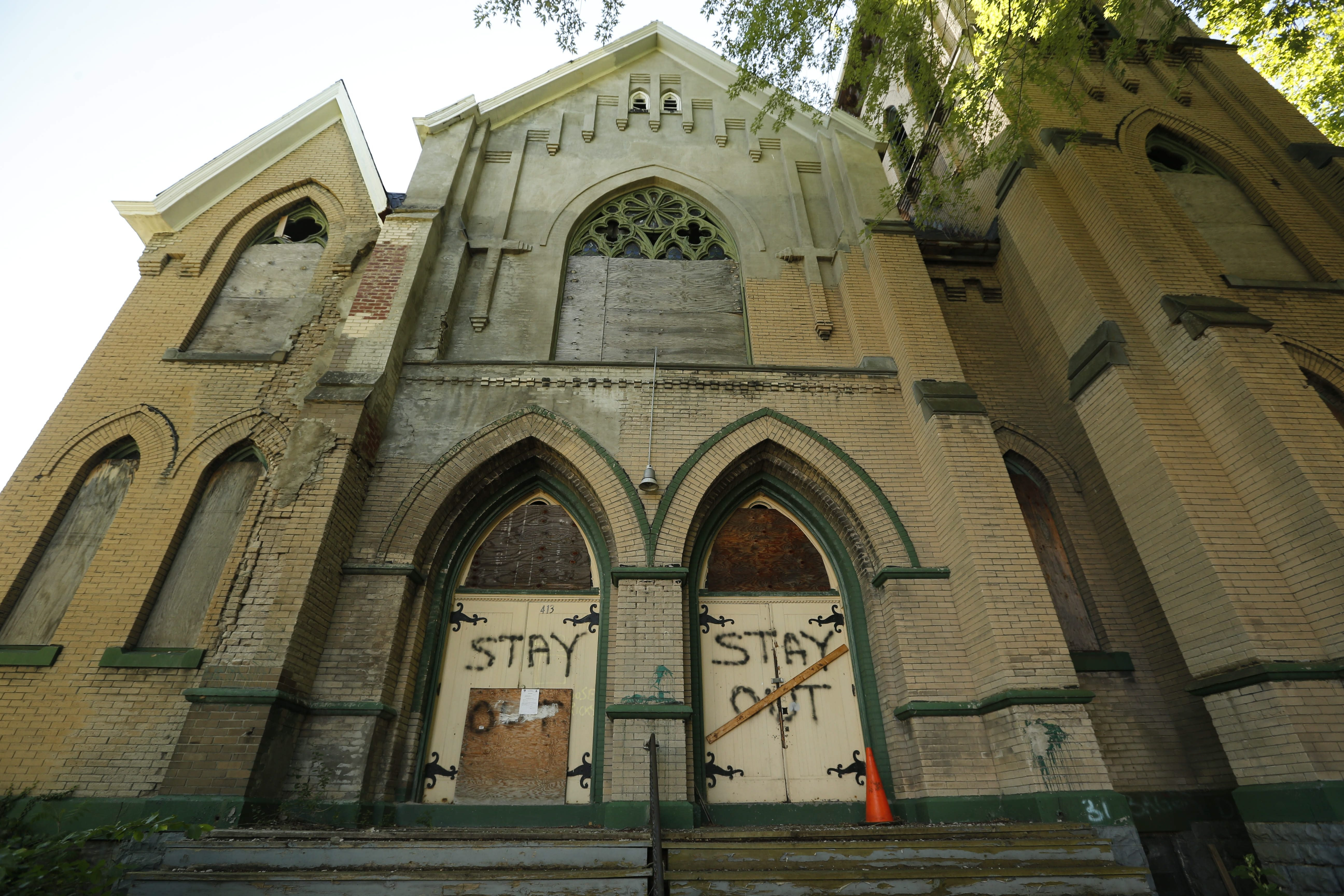 The former Salem Evangelical Reformed Church building at 413 Sherman St. has been decaying since it was purchased four years ago. (Derek Gee/Buffalo News)